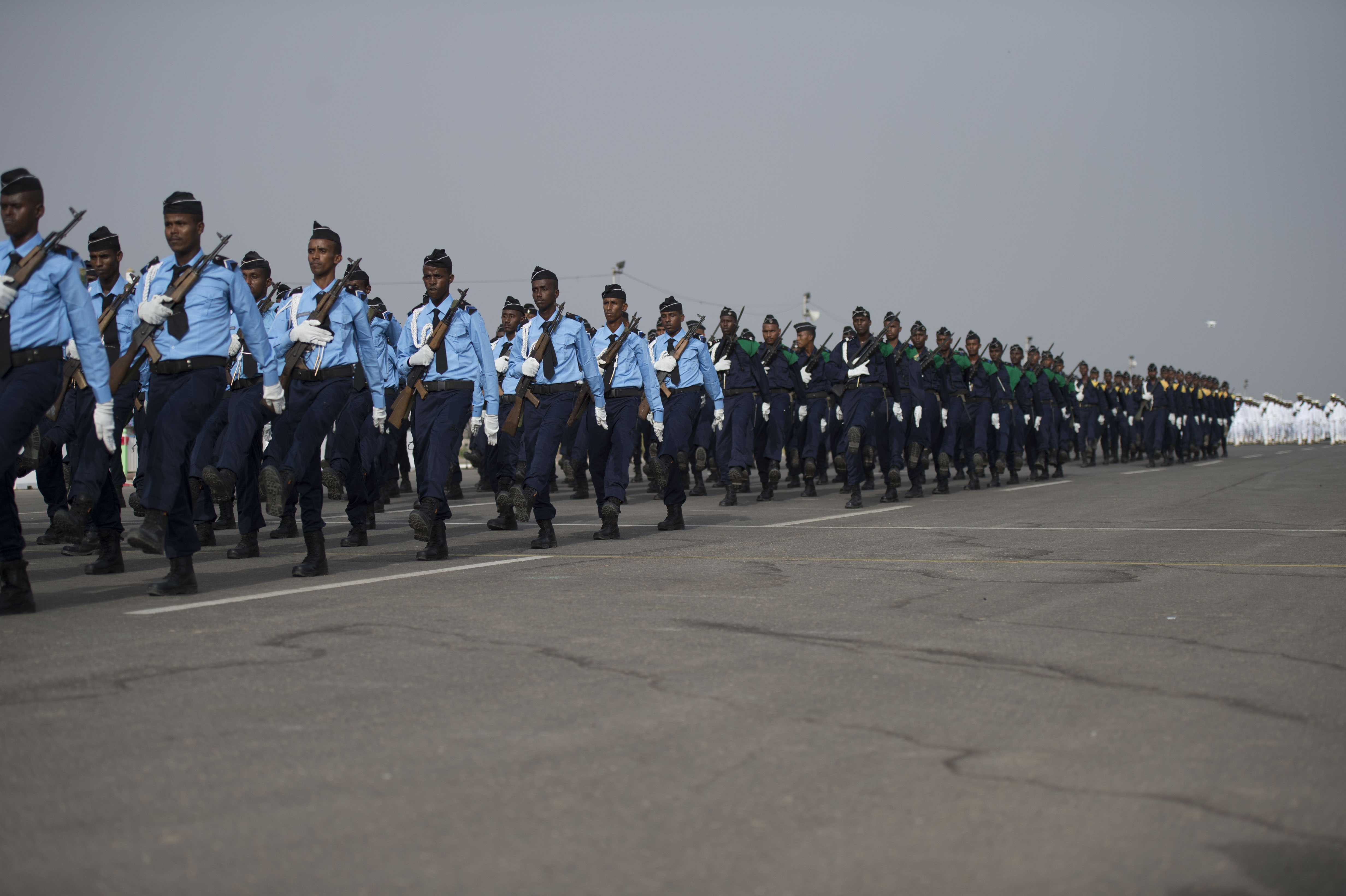 Members from multiple branches of the Djibouti Armed Forces march in unison during the Djibouti Independence Day parade June 27, 2016, at Djibouti. Service members from all Djiboutian military branches participated in the parade. (U.S. Air Force photo by Staff Sgt. Eric Summers Jr.)