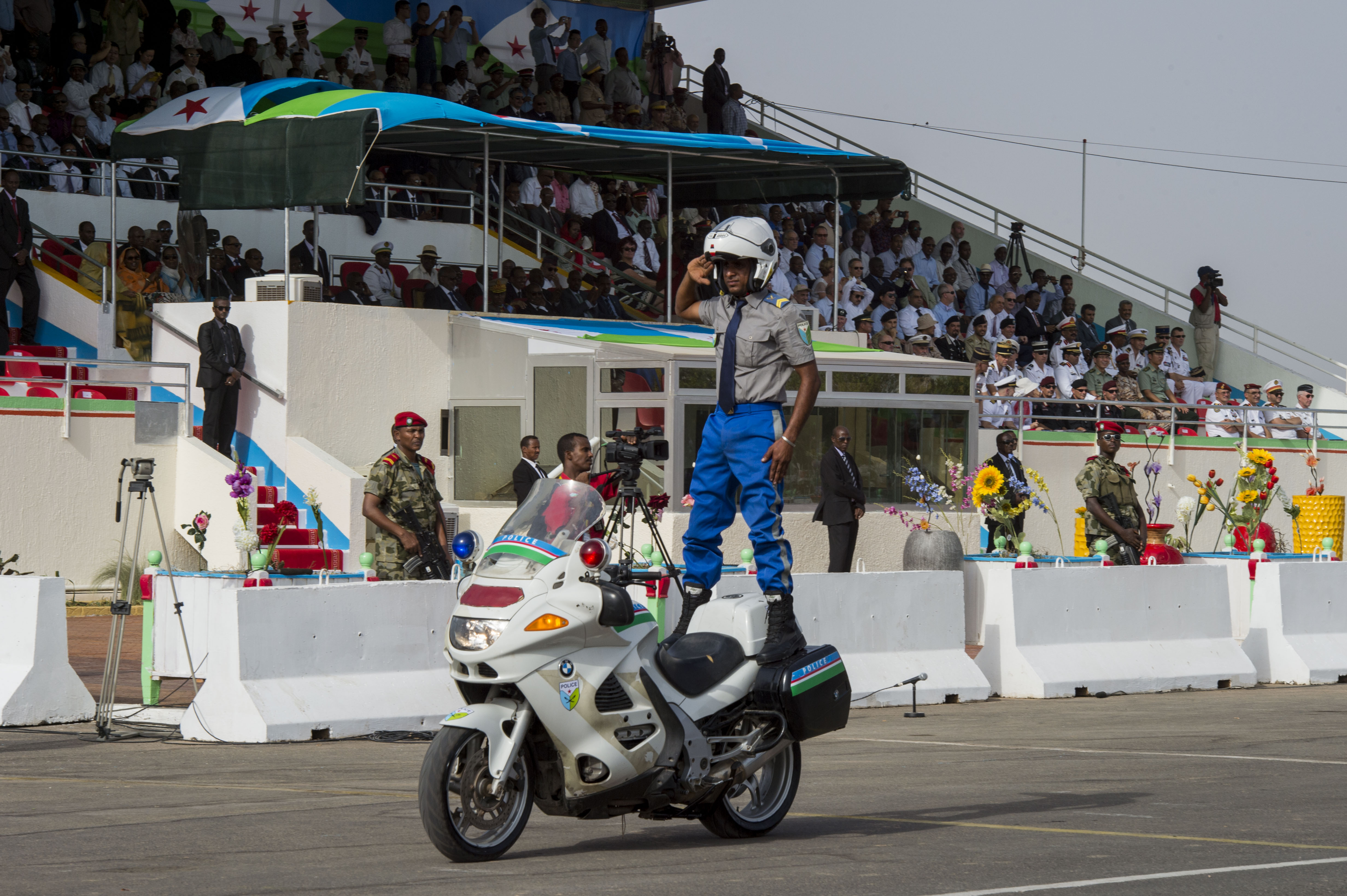 A Djiboutian police officer displays acrobatic skills during the Djibouti Independence Day parade June 27, 2016, at Djibouti. The parade included marching units from each of Djibouti's military branches and law enforcement, as well as armored vehicles. (U.S. Air Force photo by Staff Sgt. Eric Summers Jr.)