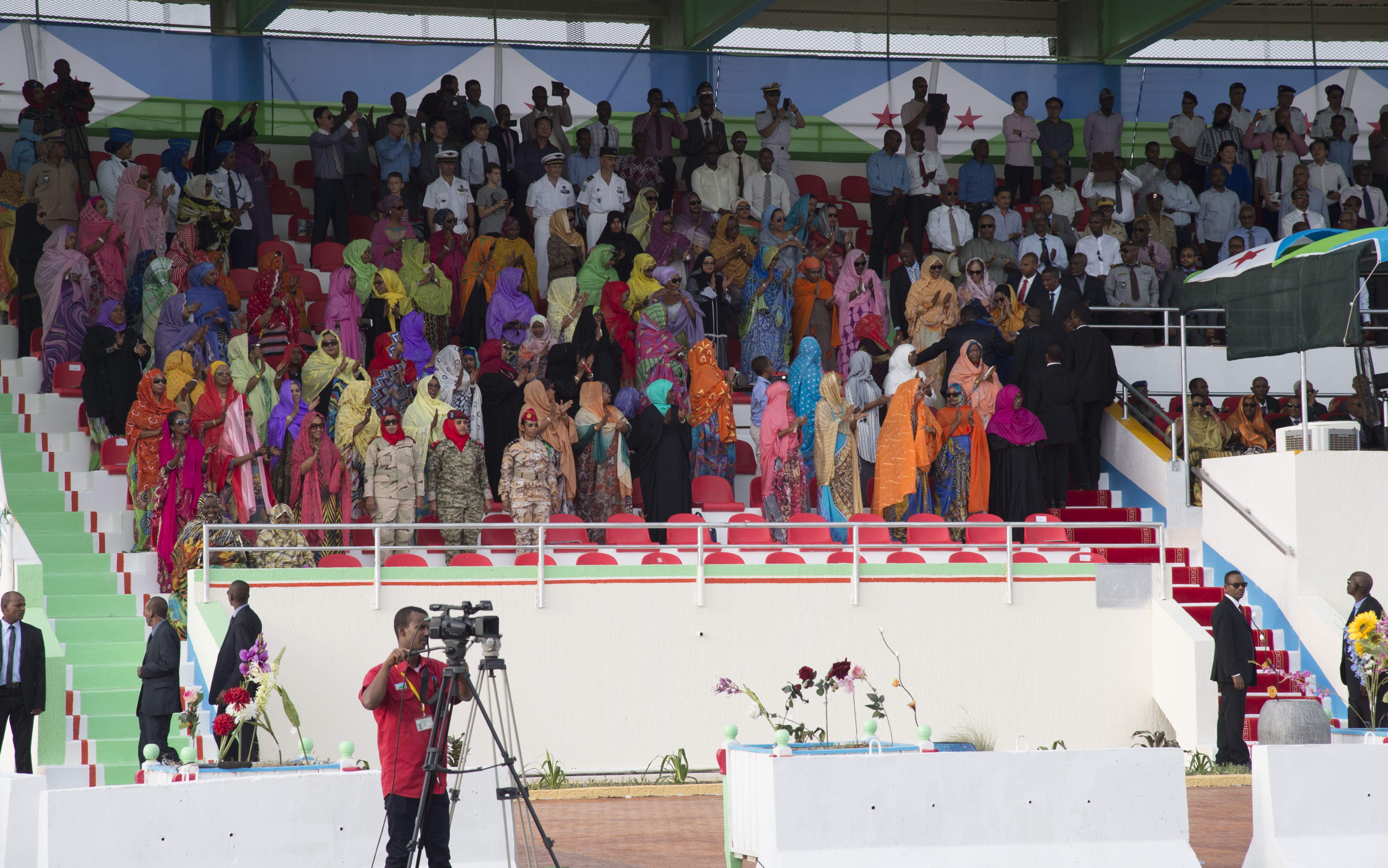 Audience members clap and repeat cadences while watching the Djibouti Independence Day parade June 27, 2016, at Djibouti. Thousands of Djiboutian citizens came to the event to watch the demonstrations by the Djiboutian military and law enforcement. (U.S. Air Force photo by Staff Sgt. Eric Summers Jr.)