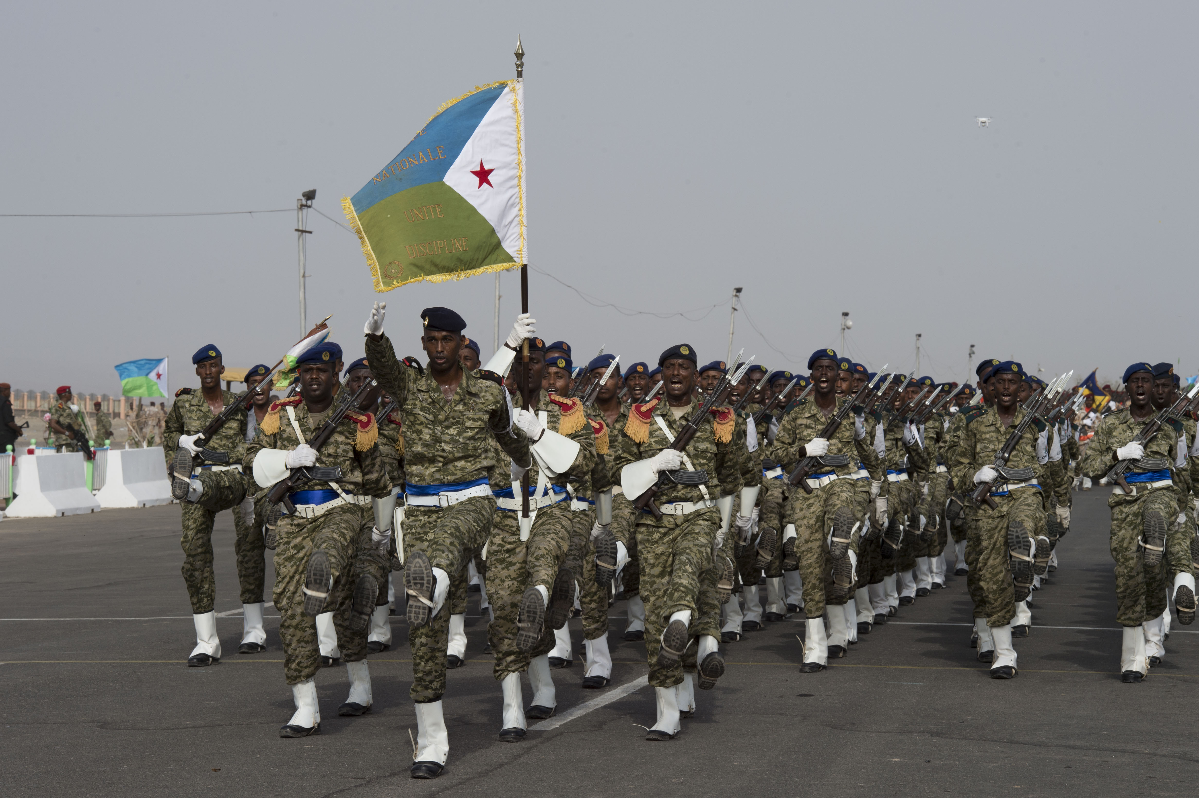 Members of the Djiboutian Armed Forces march in sync during the Djibouti Independence Day parade June 27. 2016, at Djibouti. Service members from all Djiboutian military branches participated in the parade along with law enforcement. (U.S. Air Force photo by Staff Sgt. Eric Summers Jr.)