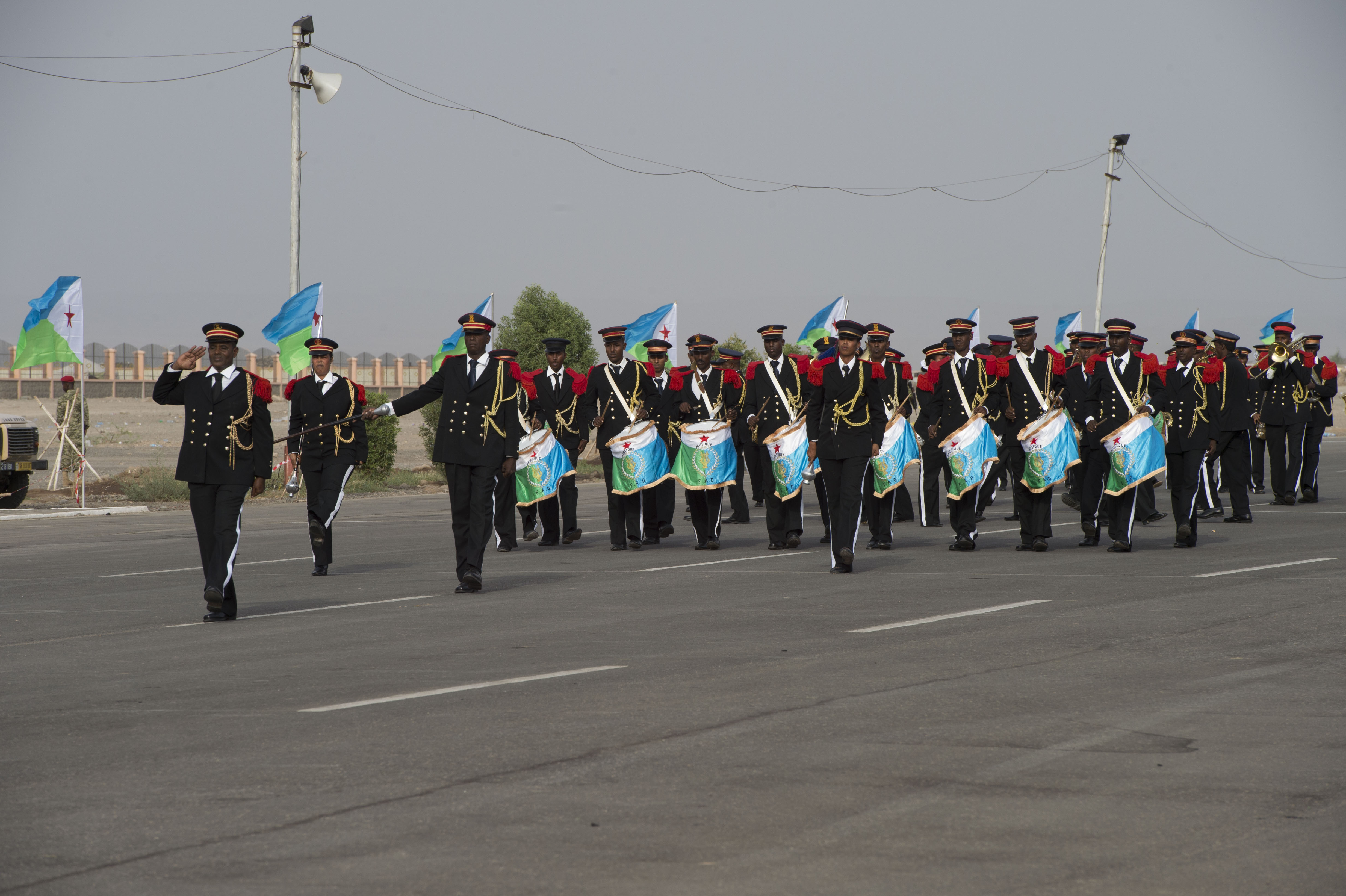 A Djiboutian band marches down the street during the Djibouti Independence Day parade June 27, 2016, at Djibouti. The band was the first of many participants in the parade. (U.S. Air Force photo by Staff Sgt. Eric Summers Jr.)