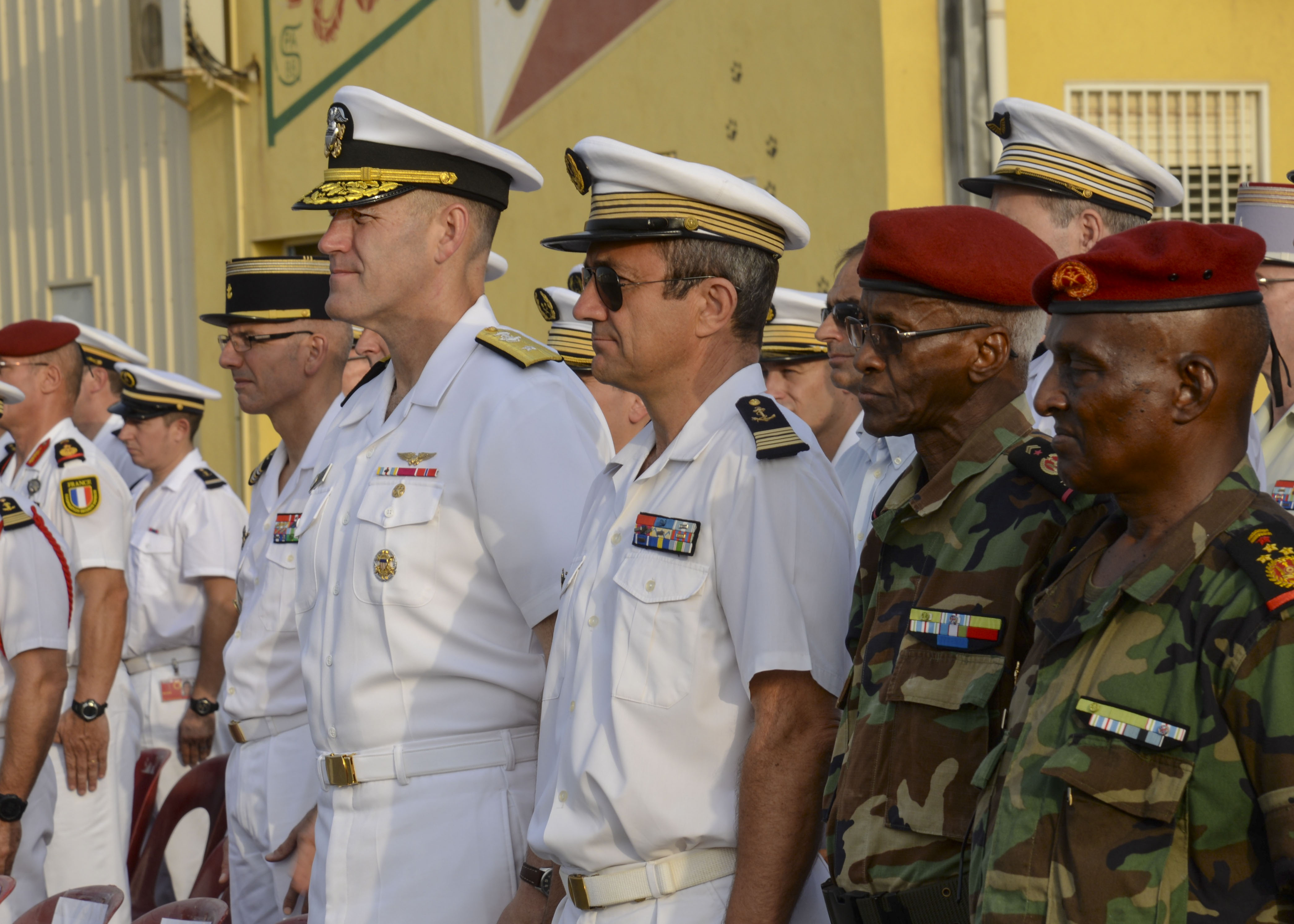 U.S. Navy Rear Adm. William W. Wheeler, Combined Joint Task Force-Horn of Africa vice commander, left, watches a French military parade in commemoration of Bastille Day (also commonly referred to as French National Day) at the French base in Djibouti, July 14, 2016. The Honorable Tom Kelly, U.S. Ambassador to Djibouti, as well as military members from Italy, Japan and others attended the ceremony. (U.S. Air Force photo by Staff Sgt. Benjamin Raughton/Released)