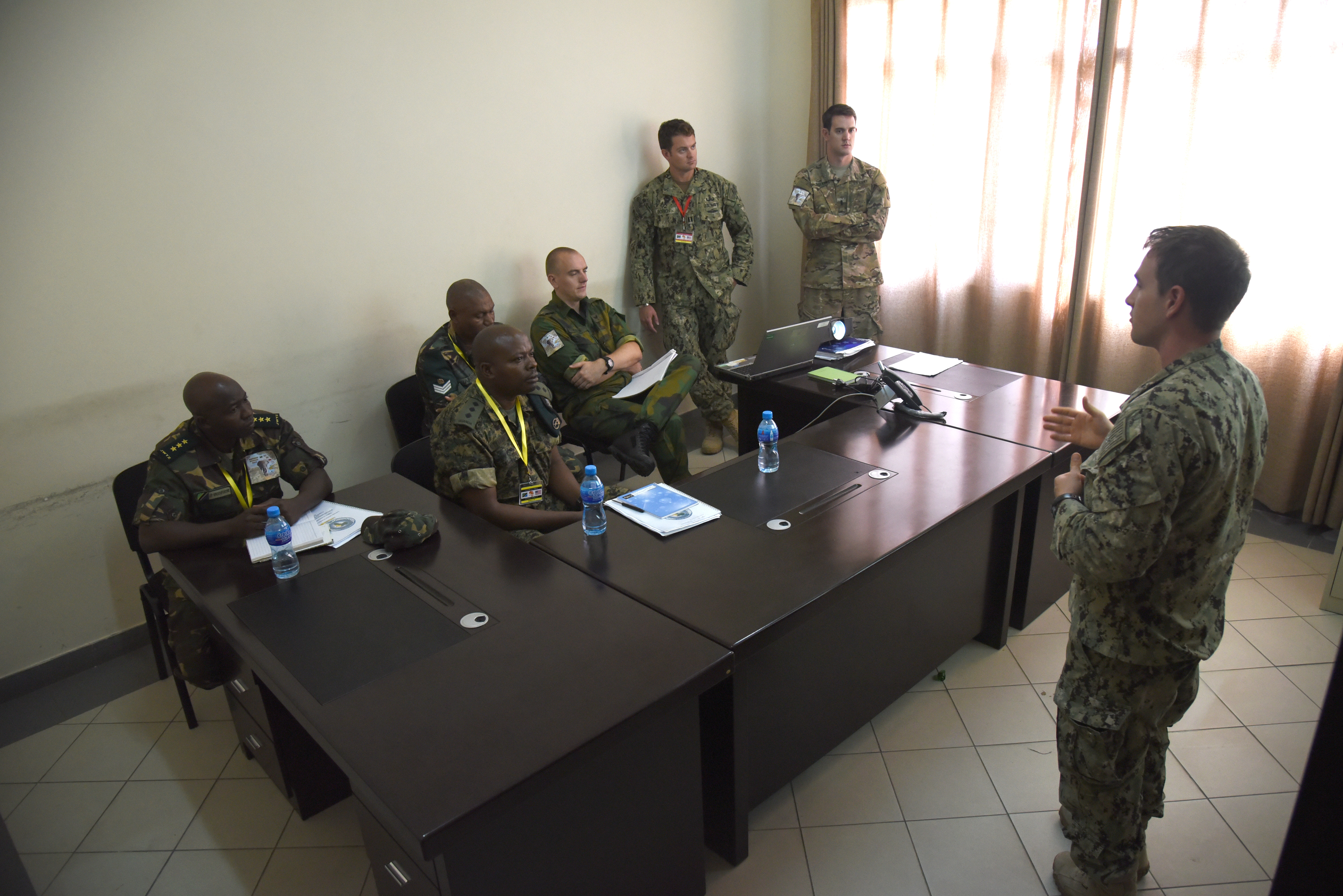 DAR ES SALAAM, Tanzania- U.S. Navy Lt. Allan Lucas, Task Force Sparta explosive ordnance disposal platoon leader at Combined Joint Task Force-Horn Of Africa, instructs a portion of a counter-improvised explosive device course to Dutch, Tanzanian and Ugandan exercise participants during Eastern Accord 2016, at the Tanzanian Peacekeeping Training Centre, in Dar es Salaam, Tanzania. EA16 is an annual, combined, joint military exercise that brings together partner nations to practice and demonstrate proficiency in conducting peacekeeping operations. (U.S. Air Force photo by Staff Sgt. Tiffany DeNault)