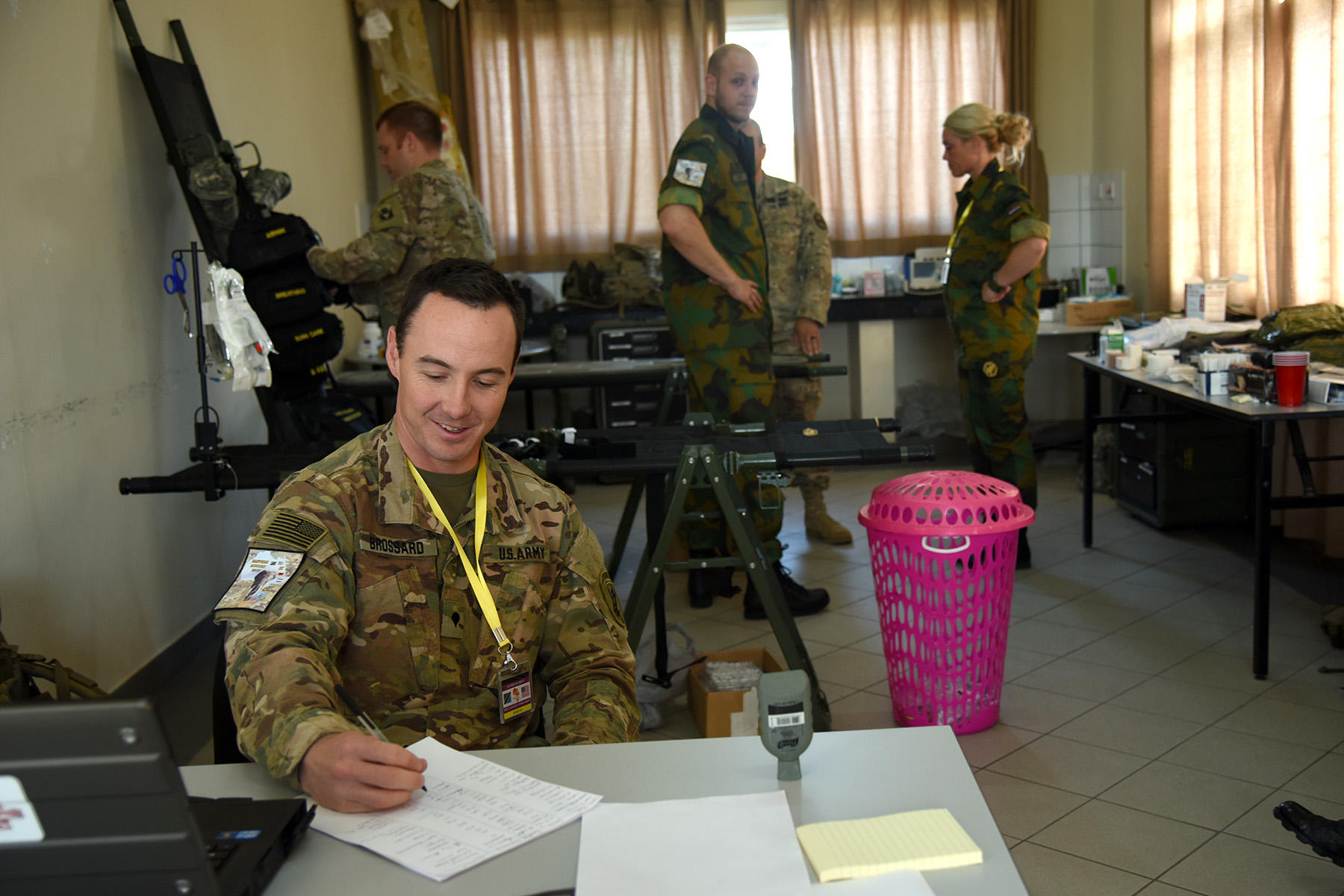 DAR ES SALAAM, Tanzania - U.S. Army Spc. Ron Brossard, Eastern Accord 2016 medical support team medic, writes notes on the patient check in sheet at the Tanzanian Peacekeeping Training Centre, July 15, 2016, in Dar es Salaam, Tanzania. The Dutch, Ugandan and U.S. medical team supports approximately 200 personnel for the annual, combined, joint military exercise that brings together nine partner nations to practice and demonstrate proficiency in conducting peacekeeping operations. (U.S. Air Force photo by Staff Sgt. Tiffany DeNault)