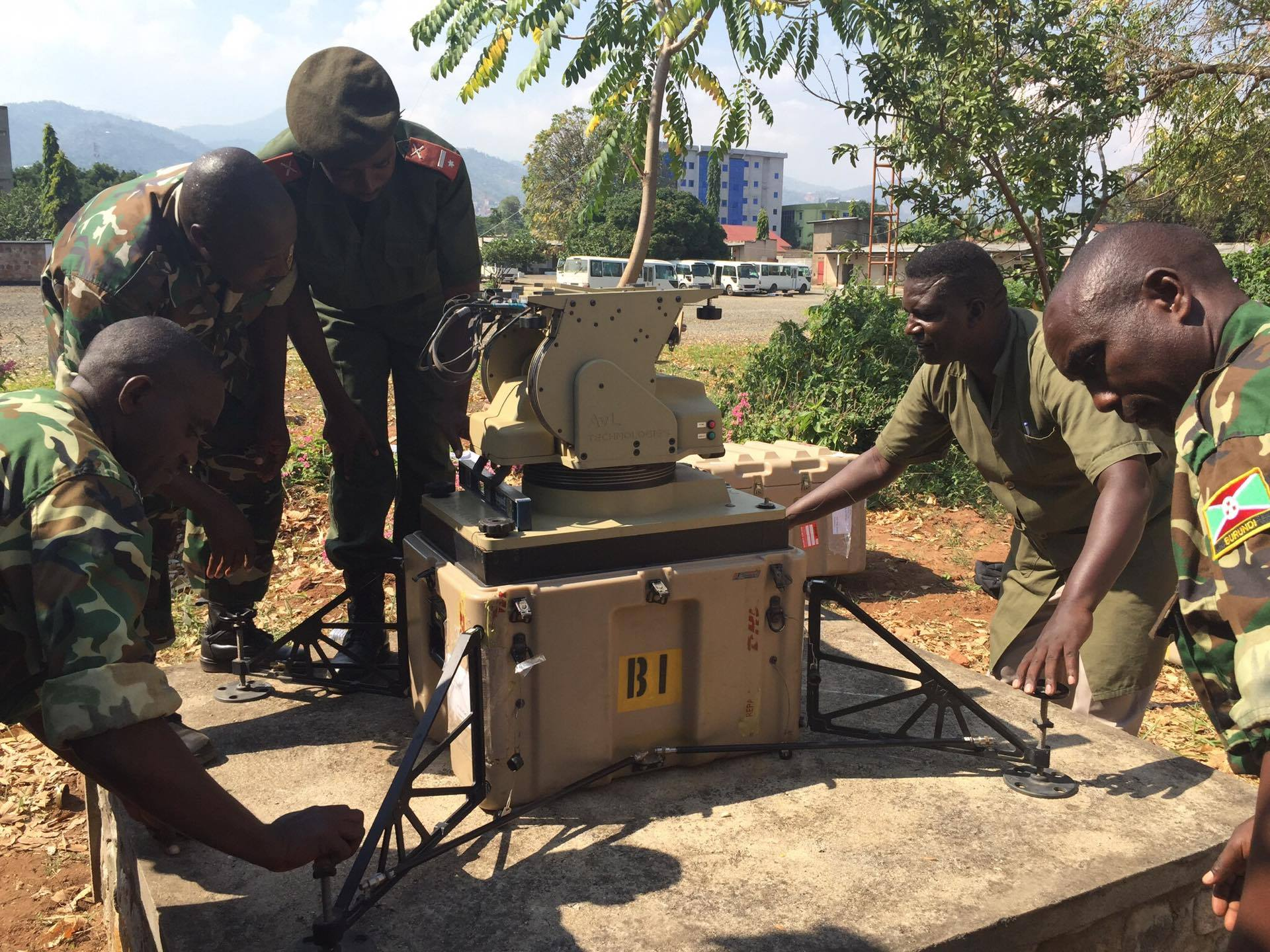 Burundian National Defense Force Soldiers work together to install their African Data Sharing Network termianl. Combined Joint Task Force–Horn of Africa communications Soldiers led a sharing of best practices for installing, operating, and maintaining their satellite terminal, June 8 – 17, 2016. The ADSN communication package provides a dynamic intelligence sharing platform for the African Union Mission in Somalia's troop contributing countries. (U.S. Army photo by 1st Lt. Justin R. Klatt)