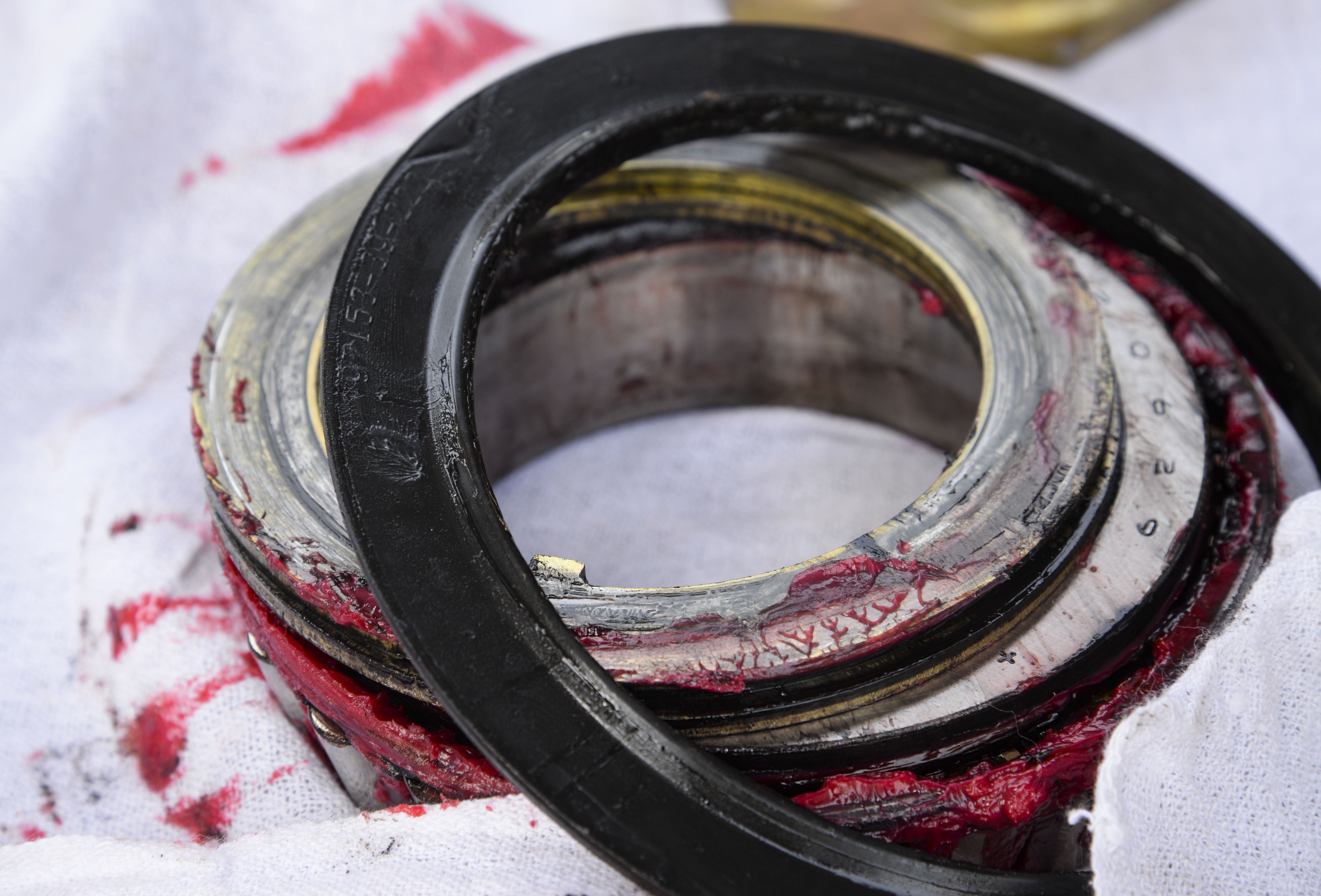 Bearings covered in red grease sit on a towel before being replaced on a C-130J Hercules during a tire change at Camp Lemonnier, Djibouti, July 18, 2016. The C-130J underwent routine maintenance to continue the mission of personnel recovery and protect and defend United States interests in Eastern Africa. (U.S. Air Force photo by Staff Sgt. Benjamin Raughton)