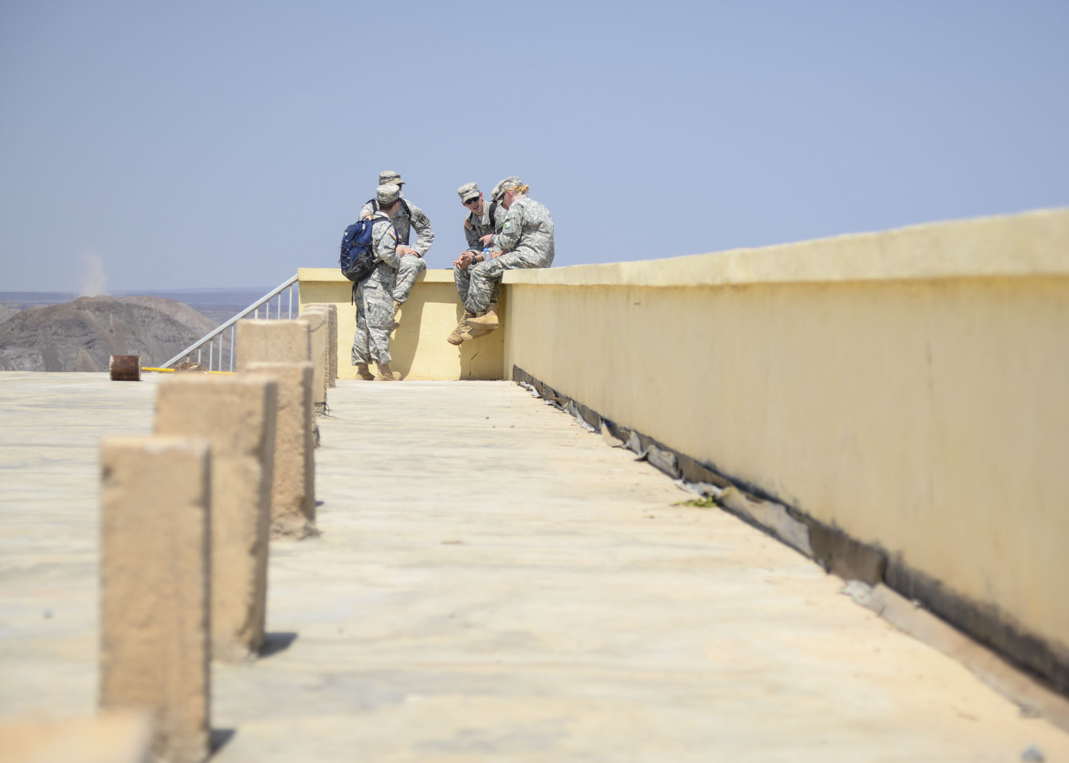 A group of U.S. Army Reserve Officer Training Corps cadets talks during a break at the Djiboutian Army Academy in Arta, Djibouti, July 25, 2016. The cadets are spending three weeks with the Djiboutian Army in a culture exchange program, where they are learning each other's language and methods of military operations. (U.S. Air Force photo by Staff Sgt. Benjamin Raughton/Released)