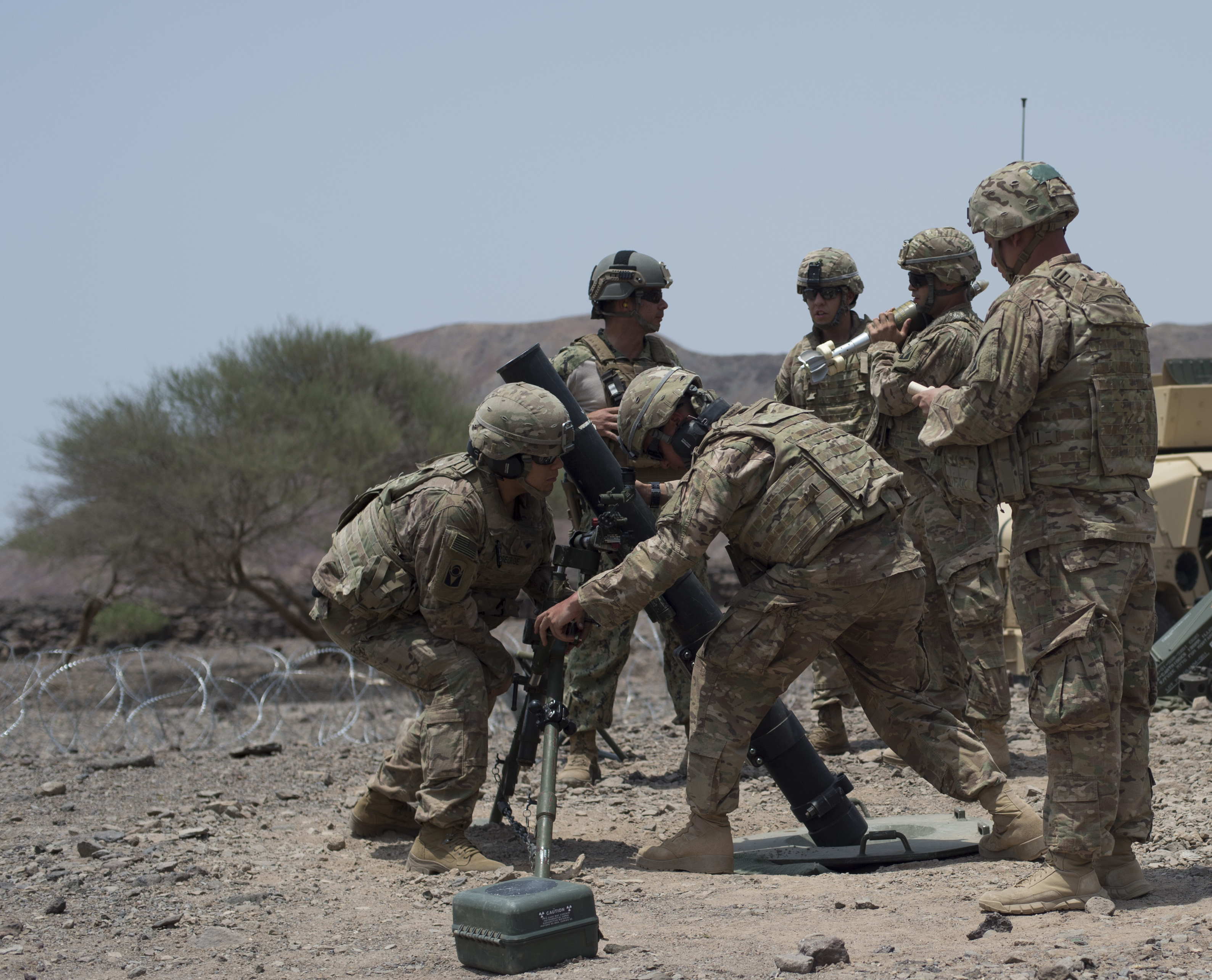 U.S. Army Soldiers from the 1st Battalion, 124th Infantry Regiment, Bravo Company adjusts the trajectory of a mortar launcher before firing a round Aug. 8, 2016, at Arta, Djibouti. The M252 cannon system has a range of 7,500 meters or approximately 4.5 miles. The 1-124 is a guard unit deployed from Cocoa, Fla., to Combined Joint Task Force-Horn of Africa. (U.S. Air Force Air Force photo by Staff Sgt. Eric Summers Jr./Released)