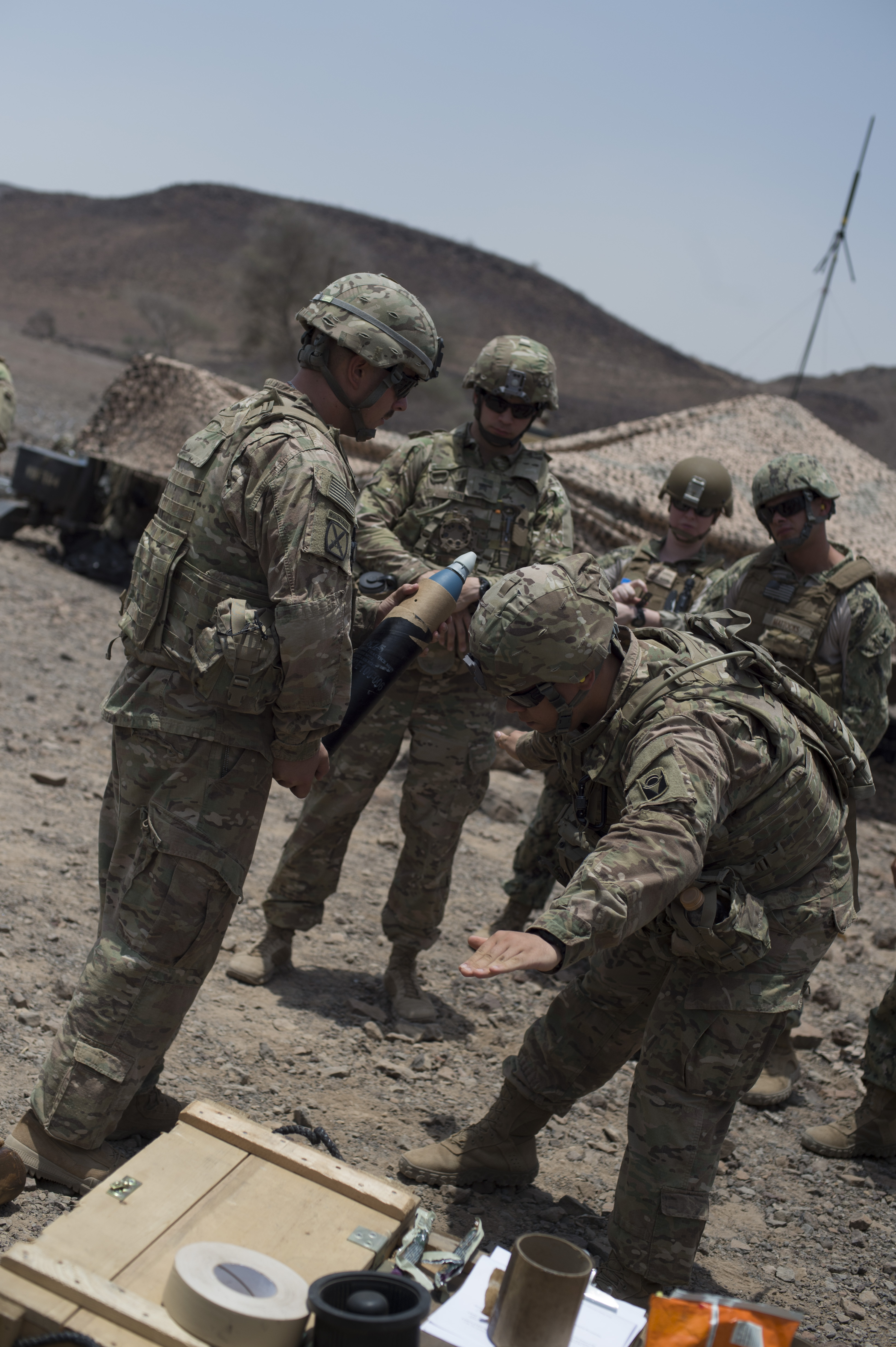 U.S. Army Soldiers from the 1st Battalion, 124th Infantry Regiment, Bravo Company demonstrate procedures for firing a mortar Aug. 8, 2016, at Arta, Djibouti. The training was conducted to ensure the unit remained proficient in using mortar artillery.  The 1-124 is a guard unit deployed from Cocoa, Fla., to Combined Joint Task Force-Horn of Africa. (U.S. Air Force Air Force photo by Staff Sgt. Eric Summers Jr./Released)
