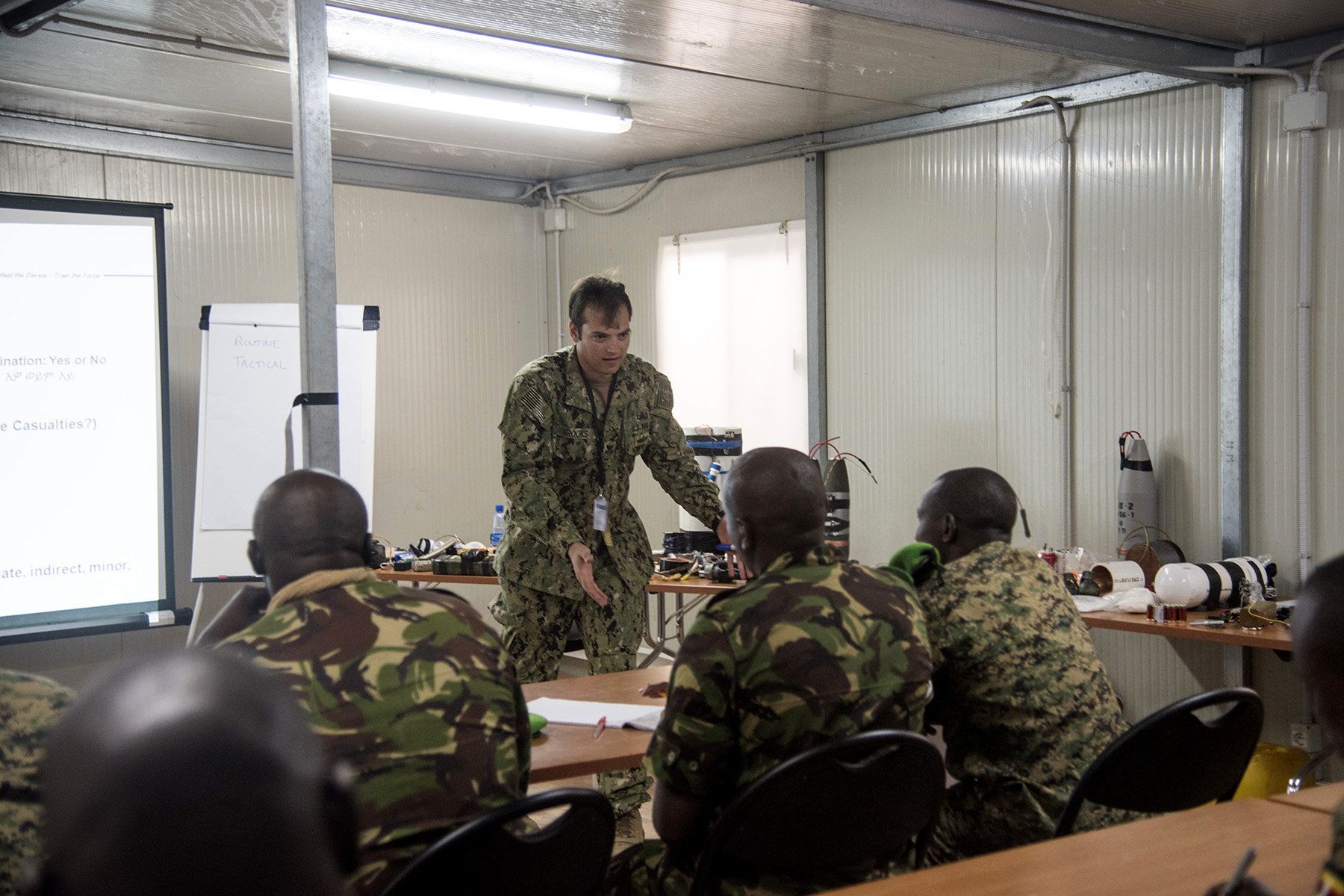 MOGADISHU, Somalia- U.S. Navy Explosive Ordnance Disposal 1st Class Tyler Brooks, Task Force Sparta, teaches how to identify and counter improvised explosive devices to participants from African Union Mission in Somalia troop contributing countries, at the Joint Military Training Center, Aug. 25, 2016, in Mogadishu, Somalia. The AMISOM soldiers learned how to effectively detect and combat IEDs to continue their efforts in regional security and stability in Somalia. Task Force Sparta members are a part of the Combined Joint Task Force-Horn of Africa, which works to strengthen Eastern African partners in countering and neutralizing violent extremists in Somalia and the region.   (U.S. Air Force photo by Staff Sgt. Tiffany DeNault)