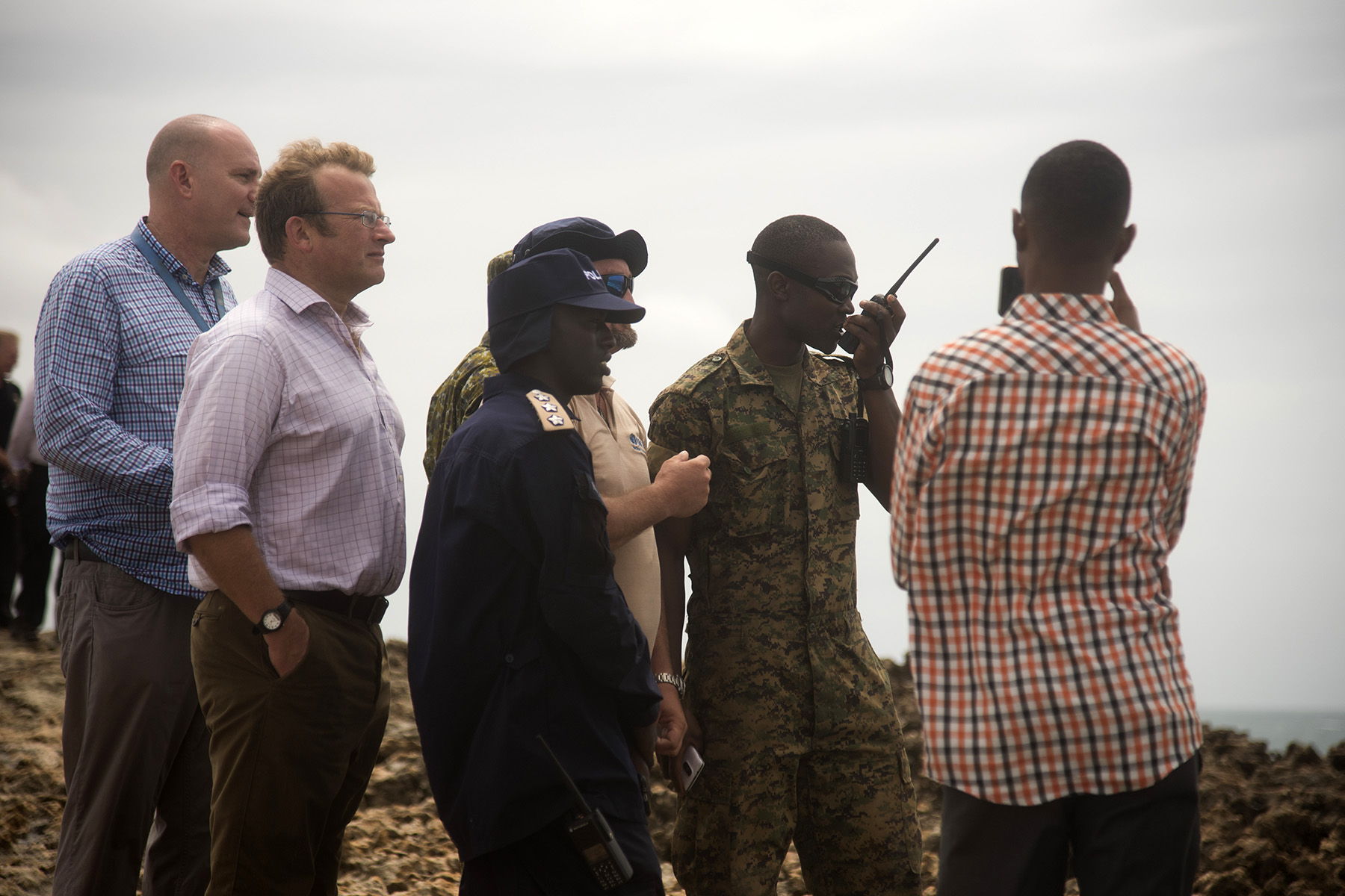 MOGADISHU, Somalia- Representatives from United Nations Office on Drugs and Crime gather with exercise leads to conduct a Somali Police Force Maritime Police Unit exercise to demonstrate capabilities with its two new vessels, Aug. 25, 2016, in Mogadishu, Somalia. The boat teams demonstrated interdiction operations to representatives from approximately seven countries involved in improving security and stability in Somalia, by capturing a mock hostile boat with exercise participants. (U.S. Air Force photo by Staff Sgt. Tiffany DeNault)