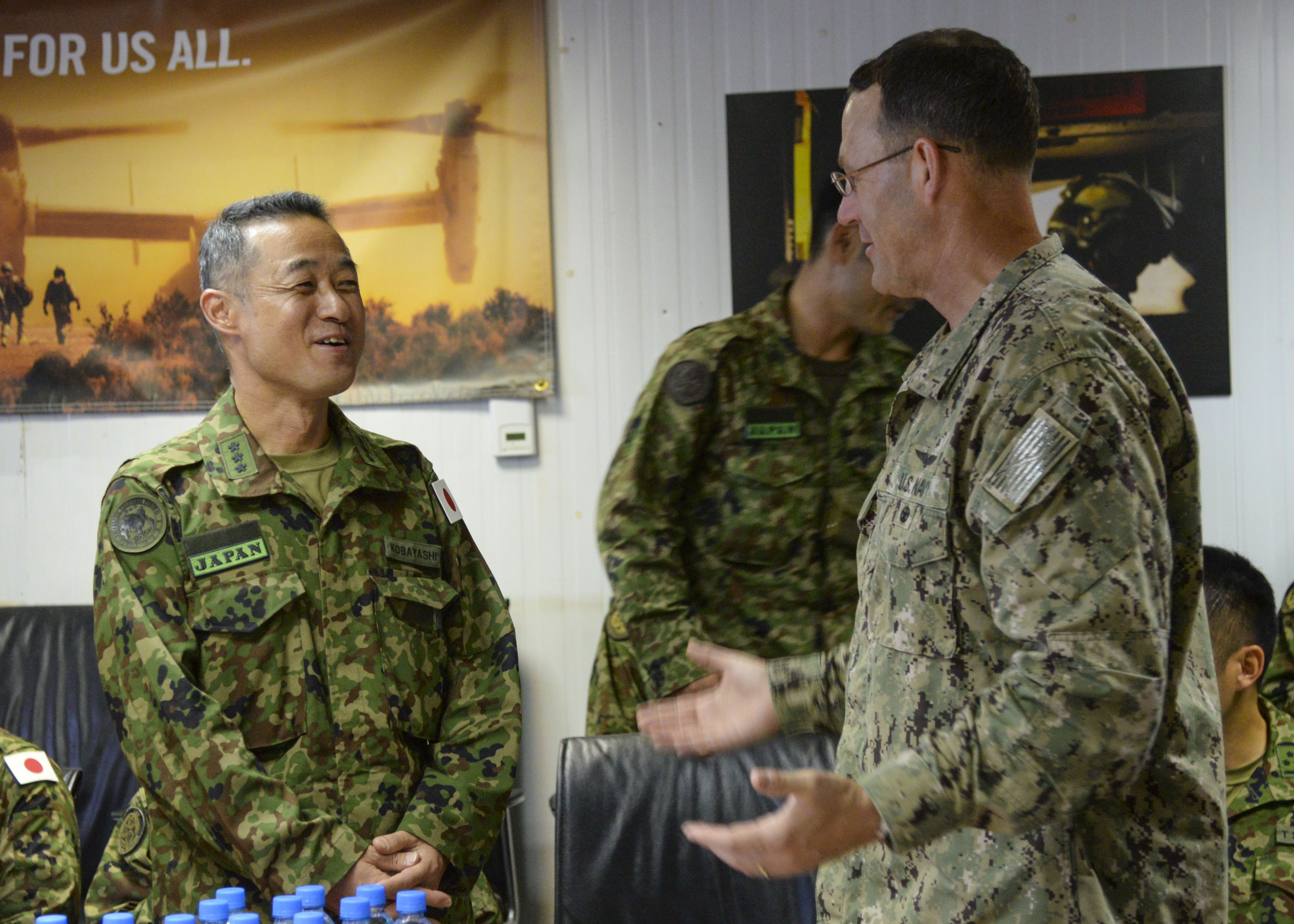 Combined Joint Task Force-Horn of Africa Deputy Commander Rear Adm. William Wheeler talks with Lt. Gen. Shigeru Kobayashi, Commander of the Japan Ground Self-Defense Force's Central Readiness Force at Camp Lemonnier, Djibouti, Aug. 27, 2016.  Japanese and CJTF-HOA service members met for a tabletop exercise to discuss how they can support each other in an event involving the evacuation of Americans or Japanese citizens from a hostile location in Africa. During the exercise, both forces discussed route planning, logistics, equipment maintenance, how military personnel would be involved, medical support and use of air and ground transportation for evacuees. The plans also examined for their strengths and weaknesses and reassessed the movement of evacuees to safety. (U.S. Air Force photo by Staff Sgt. Benjamin Raughton/Released)