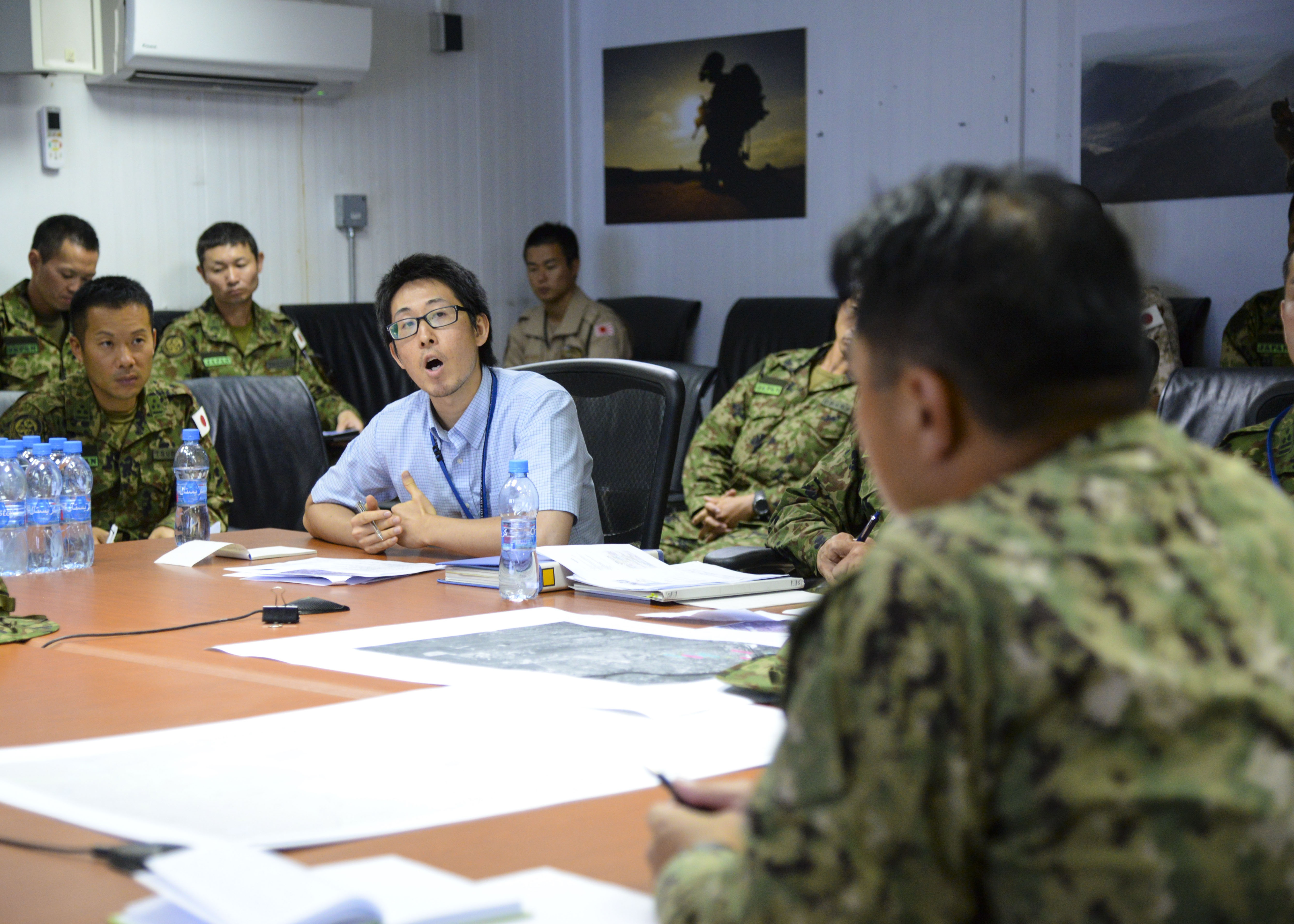 Japanese and Combined Joint Task Force-Horn of Africa service members meet for a tabletop exercise to discuss how they can support each other in an event involving the evacuation of Americans or Japanese from a hostile location in Africa, Aug. 27-28, 2016 at the Japanese base in Djibouti. During the exercise, both forces discussed route planning, logistics, equipment maintenance, how military personnel would be involved, medical support and use of air and ground transportation for evacuees. The plans also examined their strengths and weaknesses and reassessed the movement of evacuees to safety. (U.S. Air Force photo by Staff Sgt. Benjamin Raughton/Released)