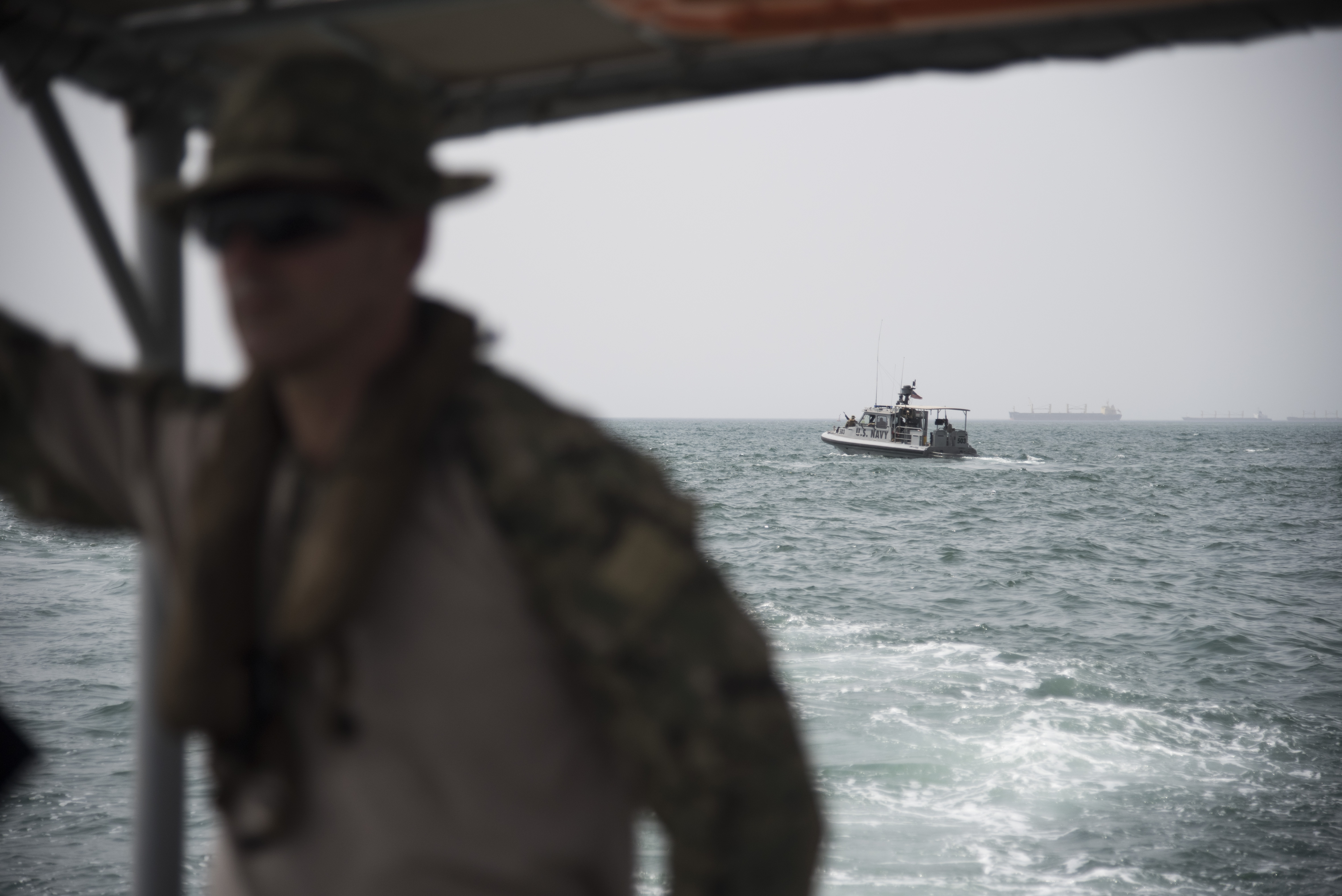 DJIBOUTI- U.S. Navy sailors with Coastal Riverine Squadron Eight, assigned to Combined Joint Task Force-Horn of Africa, provide security for a pier side U.S. asset on June 27, 2016, in Djibouti. CRS-8, out of Naval Station Newport, R.I., secures U.S. ships coming in and out of the port, and provides additional security during the ships' in-port stay. (U.S. Air Force photo by Staff Sgt. Tiffany DeNault)