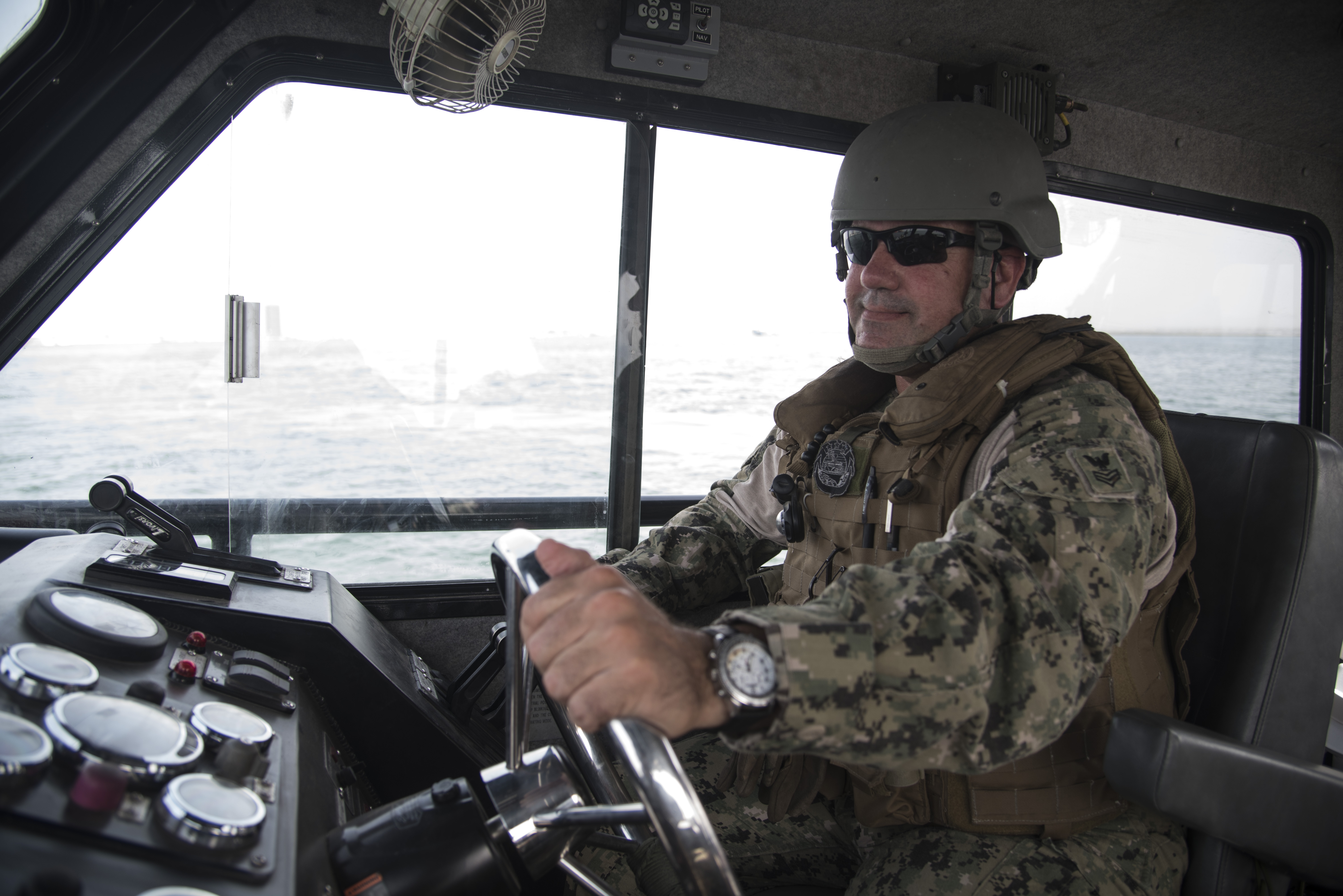 DJIBOUTI- U.S. Navy Petty Officer 1st Class James Padden, Coastal Riverine Squadron Eight boat captain assigned to Combined Joint Task Force-Horn of Africa, drives a SeaArk Dauntless patrol boat while providing security for a U.S. asset on June 27, 2016, in Djibouti. The CRS-8 provides security for any U.S. ship coming into, staying and leaving the port. (U.S. Air Force photo by Staff Sgt. Tiffany DeNault)