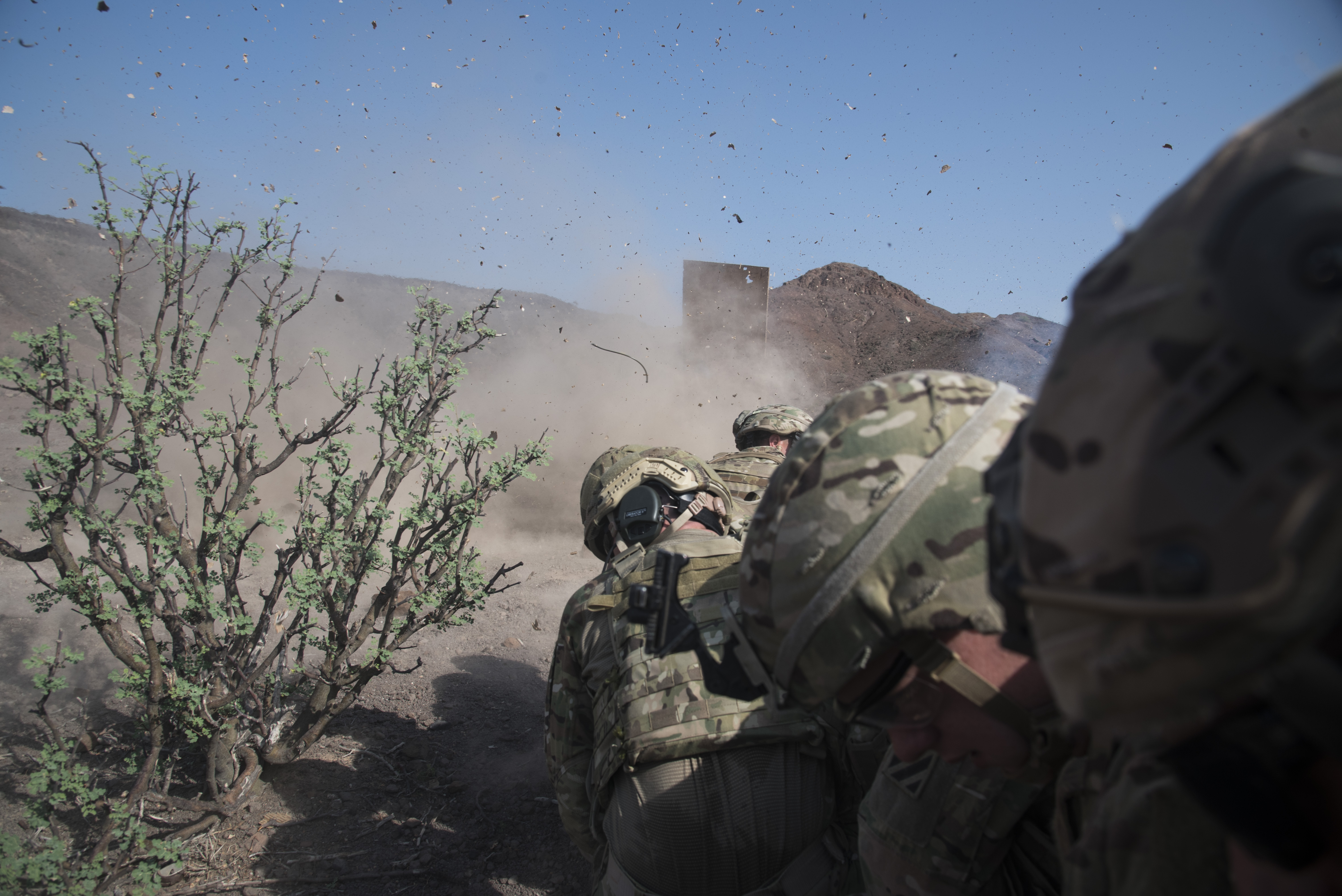 U.S. Army Soldiers from the Bravo Company, 3rd Battalion, 15th Infantry Regiment, detonate explosives secured to a wood board during demolition training to learn how to breach through buildings, Aug. 30, 2016, in Arta, Djibouti. Bravo Co. 3/15 Inf. Rgt., from Fort Stewart, Ga., serves as the East Africa Response Force assigned to Combined Joint Task Force-Horn of Africa to provide rapid response and security to protect embassies and foreign assets in the area of responsibility of CJTF-HOA. (U.S. Air Force photo by Staff Sgt. Tiffany DeNault)