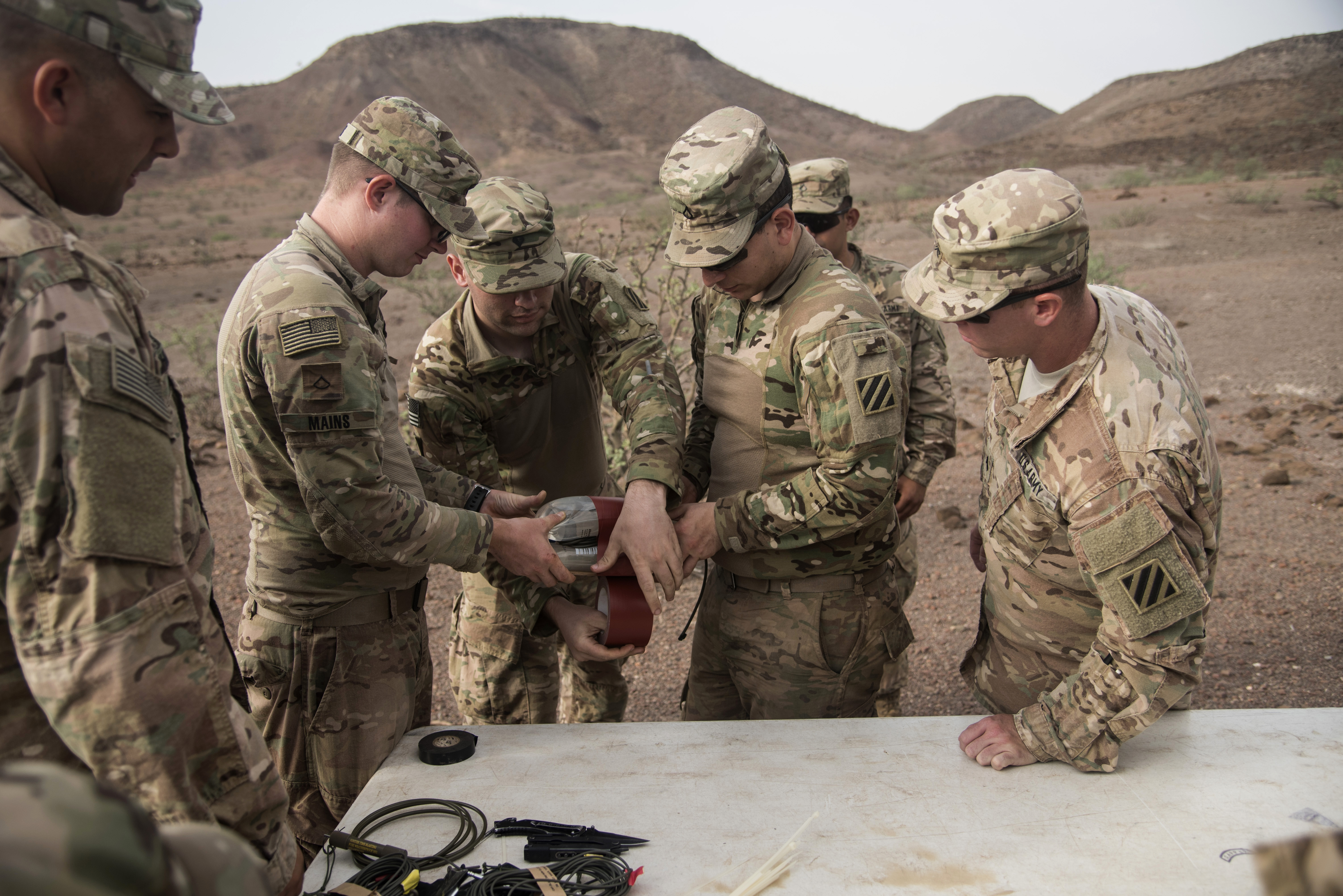 U.S. Army Soldiers from the Bravo Company, 3rd Battalion, 15th Infantry Regiment, create their water explosive packs for demolition training, Aug. 30, 2016, in Arta, Djibouti.  Bravo Co., 3/15 Inf. Rgt., from Fort Stewart, Ga., serves as the East Africa Response Force assigned to Combined Joint Task Force-Horn of Africa to provide rapid response and security to protect embassies and foreign assets in the area of responsibility of CJTF-HOA. (U.S. Air Force photo by Staff Sgt. Tiffany DeNault)