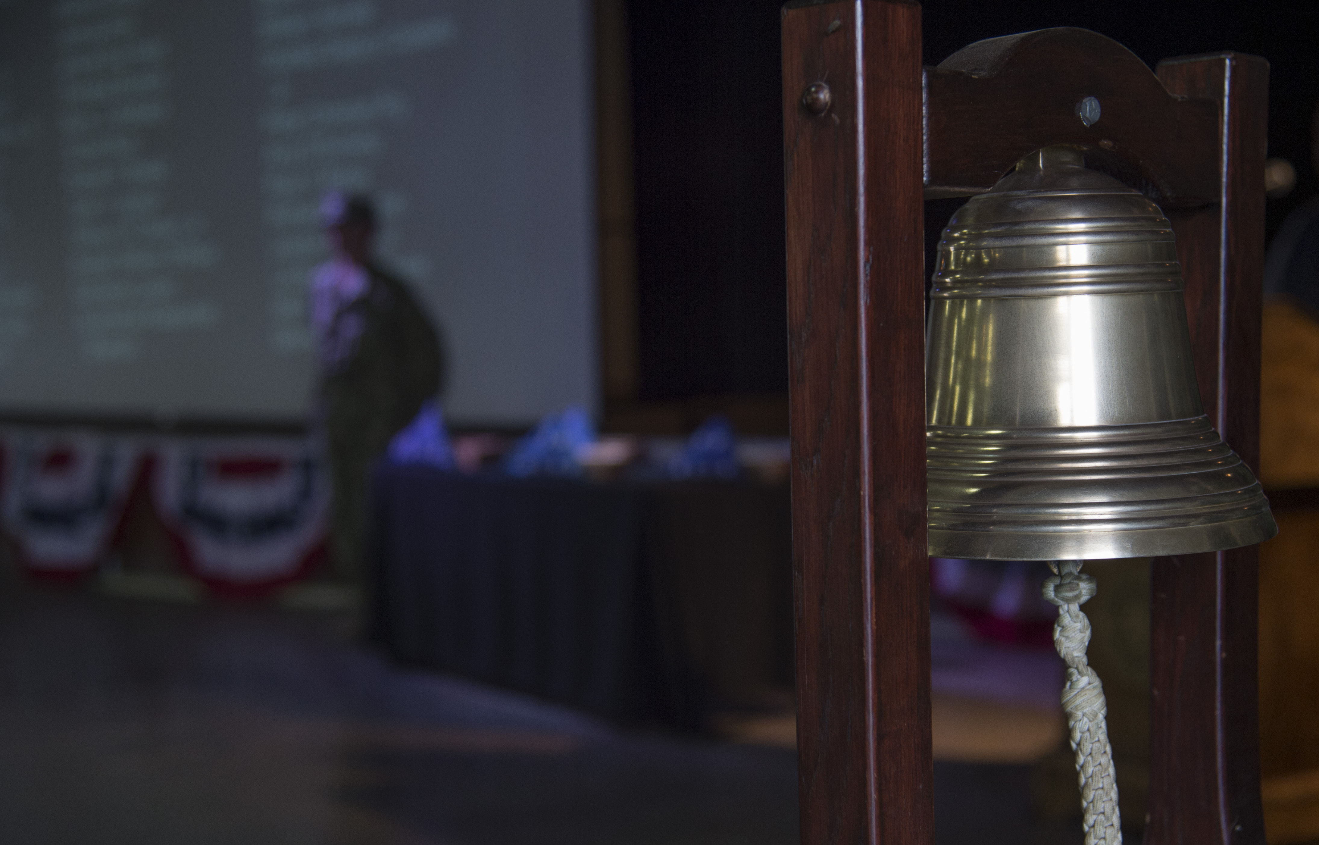 A bell that rang four times to honor the flights that were downed during the 9/11 attacks on America hangs silently during a remembrance ceremony held Sept. 11, 2016, at Camp Lemonnier, Djibouti. The ceremony was organized and conducted by Fiscal Year 2017 Chief Petty Officer selectees from Camp Lemonnier and Combined Joint Task Force - Horn of Africa.  (U.S. Air Force photo by Staff Sgt. Eric Summers Jr.)