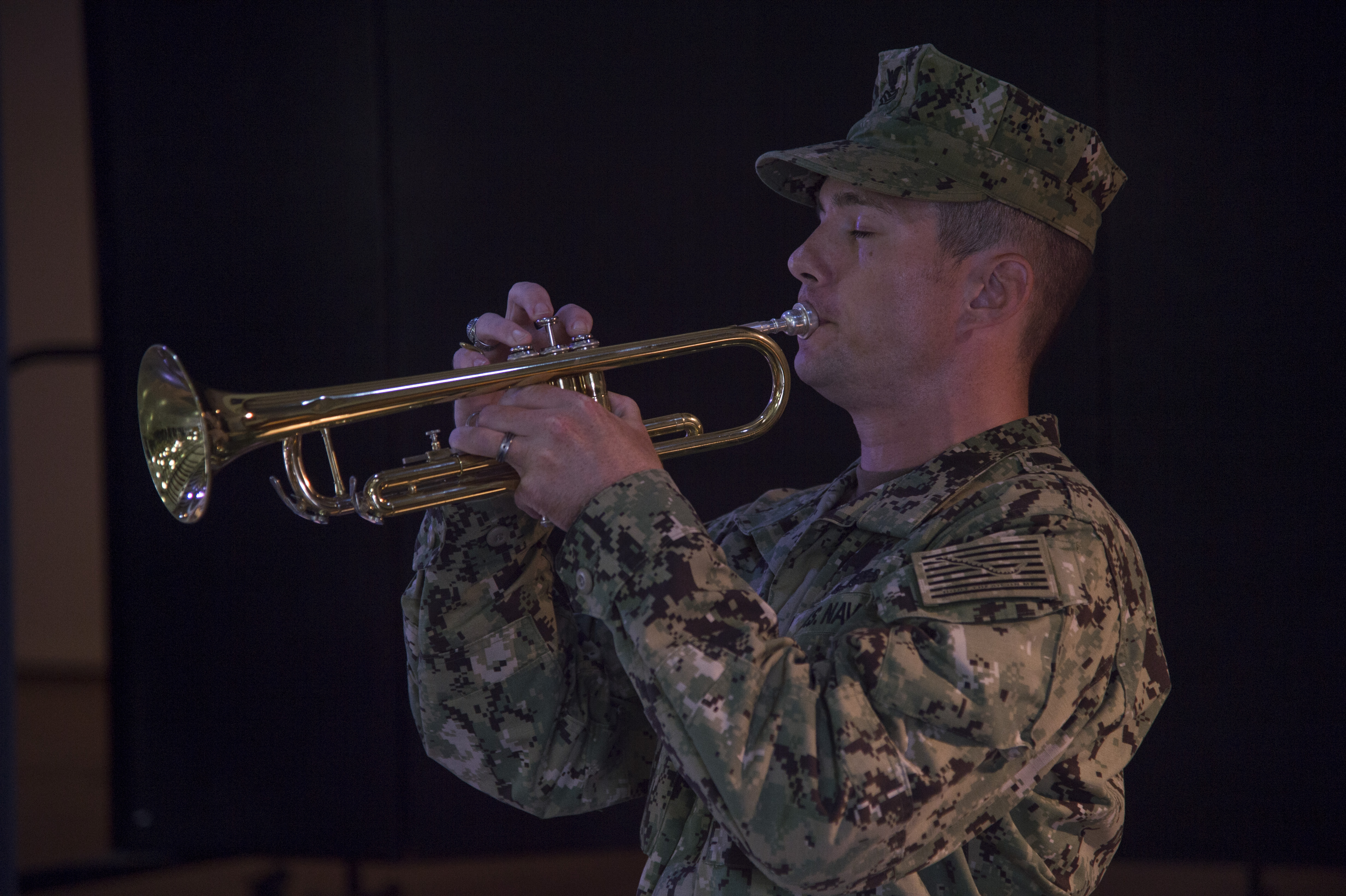Chief Gunner's Mate (Sel) Brian Ediger plays taps at the conclusion of a 9/11 remembrance ceremony held Sept. 11, 2016, at Camp Lemonnier, Djibouti. Taps in the military represents the end of a workday or time to rest. For the ceremony, it signaled the final rest for those who lost their lives during 9/11. The ceremony was organized and conducted by Fiscal Year 2017 Chief Petty Officer selectees from Camp Lemonnier and Combined Joint Task Force - Horn of Africa.  (U.S. Air Force photo by Staff Sgt. Eric Summers Jr.)