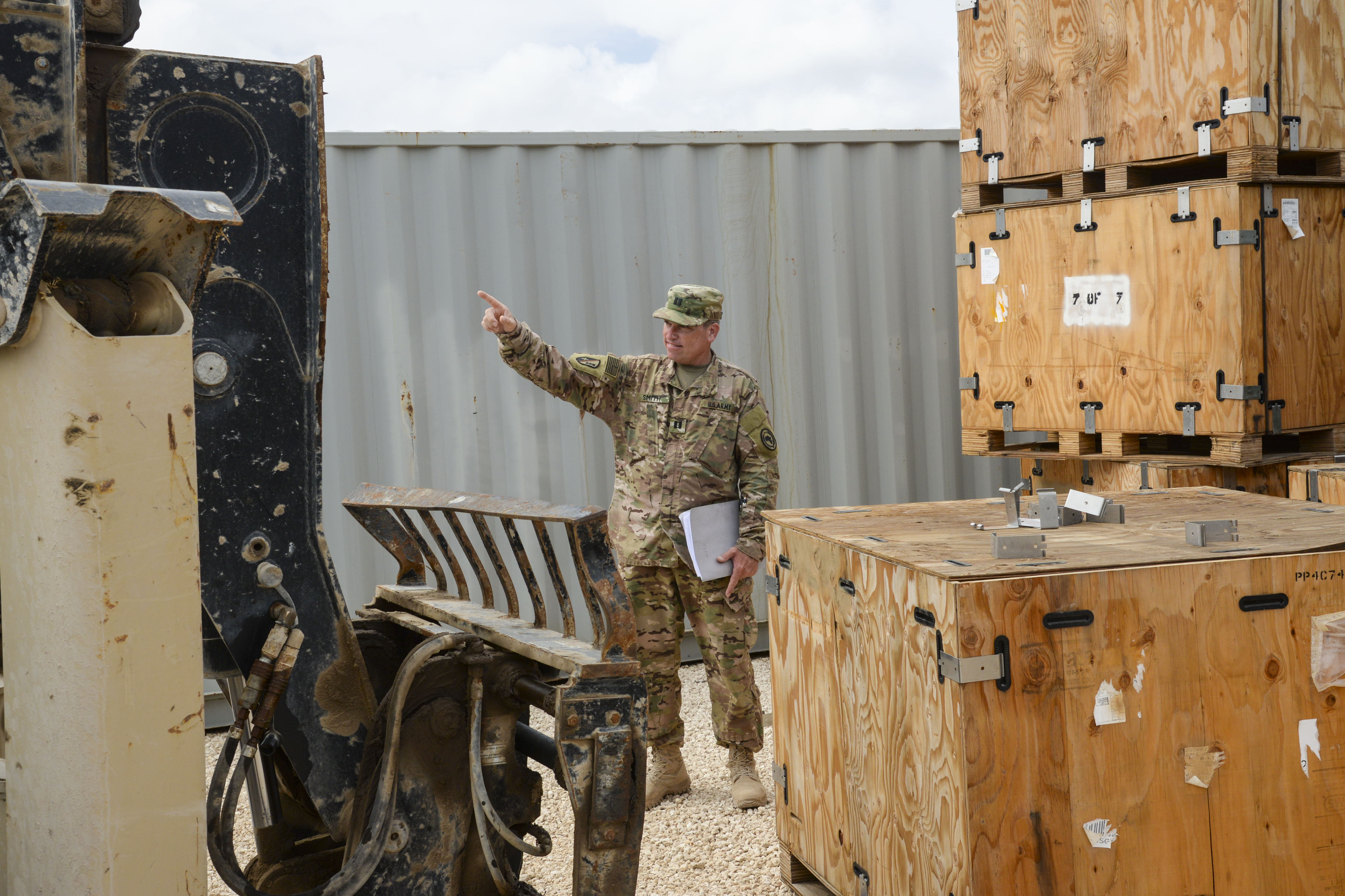U.S. Army Capt. Mike Smith, Combined Joint Task Force- Horn of Africa Military Coordination Cell logistics representative, guides a forklift to pick up crates of tires in Mogadishu, Somalia, Sept. 12, 2016. Both African Union Mission in Somalia members and U.S. forces worked together to get all supplies stored in containers for use in dry locations, as weathering and rain can damage supplies exposed to the elements. (U.S. Air Force photo by Staff Sgt. Benjamin Raughton)