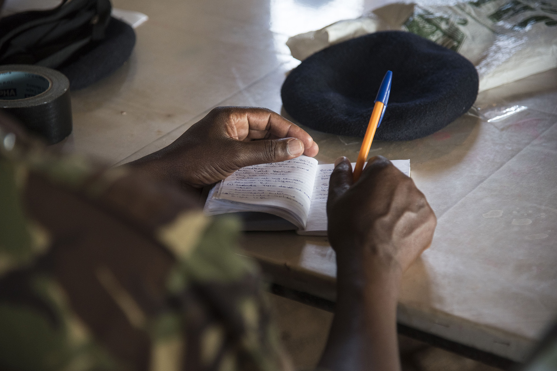 A Kenya Defense Forces Military Intelligence Battalion soldier takes notes during training on the AeroVironment RQ-11 Raven, an unmanned aerial vehicle,  Sept. 13, 2016, at a Kenyan training facility. Members of the 1st Battalion, 124th Infantry Regiment, assigned to Combined Joint Task Force-Horn of Africa, provided the KDF training on the Raven for employment in future real world situations. (U.S. Air Force photo by Staff Sgt. Tiffany DeNault)