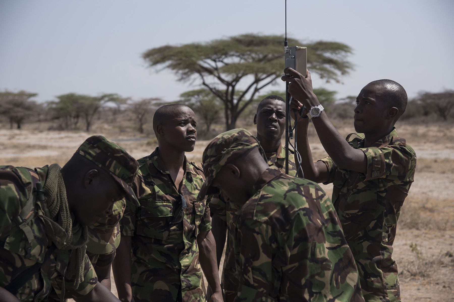 Members of the Kenya Defense Forces Military Intelligence Battalion set up the computer system and AeroVironment RQ-11 Raven, an unmanned aerial vehicle, for the flying lesson portion of training, Sept. 13, 2016, at a Kenyan training facility. Members of the 1st Battalion, 124th Infantry Regiment, assigned to Combined Joint Task Force-Horn of Africa, provided the KDF training on the Raven for employment in future real world situations. (U.S. Air Force photo by Staff Sgt. Tiffany DeNault)