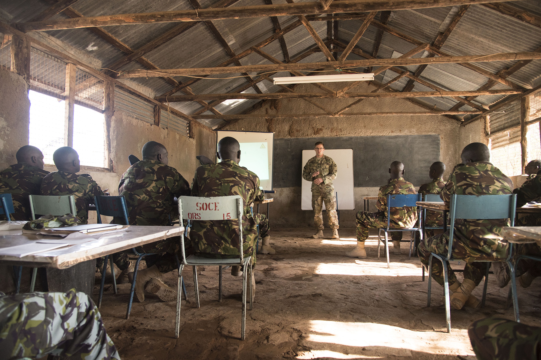 U.S. Army Staff Sgt. Charles Wirks, 1st Battalion, 124th Infantry Regiment and Raven master trainer, teaches members of the Kenya Defense Forces Military Intelligence Battalion how to tactfully use the AeroVironment RQ-11 Raven, an unmanned aerial vehicle, Sept. 13, 2016, at a Kenyan training facility. The KDF soldiers received basic training on assembly, disassembly, repair, and preventative maintenance in regard to basic mission planning and advanced flight plans for the Raven.  (U.S. Air Force photo by Staff Sgt. Tiffany DeNault)