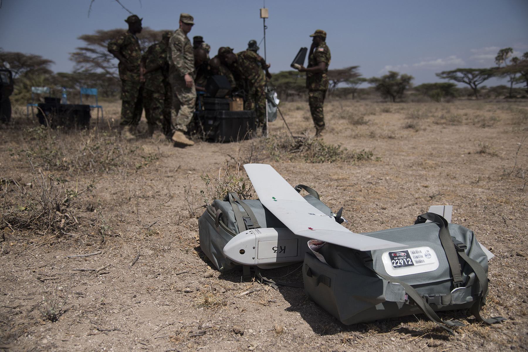 U.S. Army Soldiers of the 1st Battalion, 124th Infantry Regiment assigned to Combined Joint Task Force-Horn of Africa, and the Kenya Defense Forces Military Intelligence Battalion, set up a computer system in preparation to fly the AeroVironment RQ-11 Raven, an unmanned aerial vehicle, Sept. 13, 2016, at a Kenyan training facility. The 1/124th Inf. Rgt. Soldiers provided basic training on assembly, disassembly, repair, and preventative maintenance in regard to basic mission planning and advanced flight plans for the Raven. (U.S. Air Force photo by Staff Sgt. Tiffany DeNault)