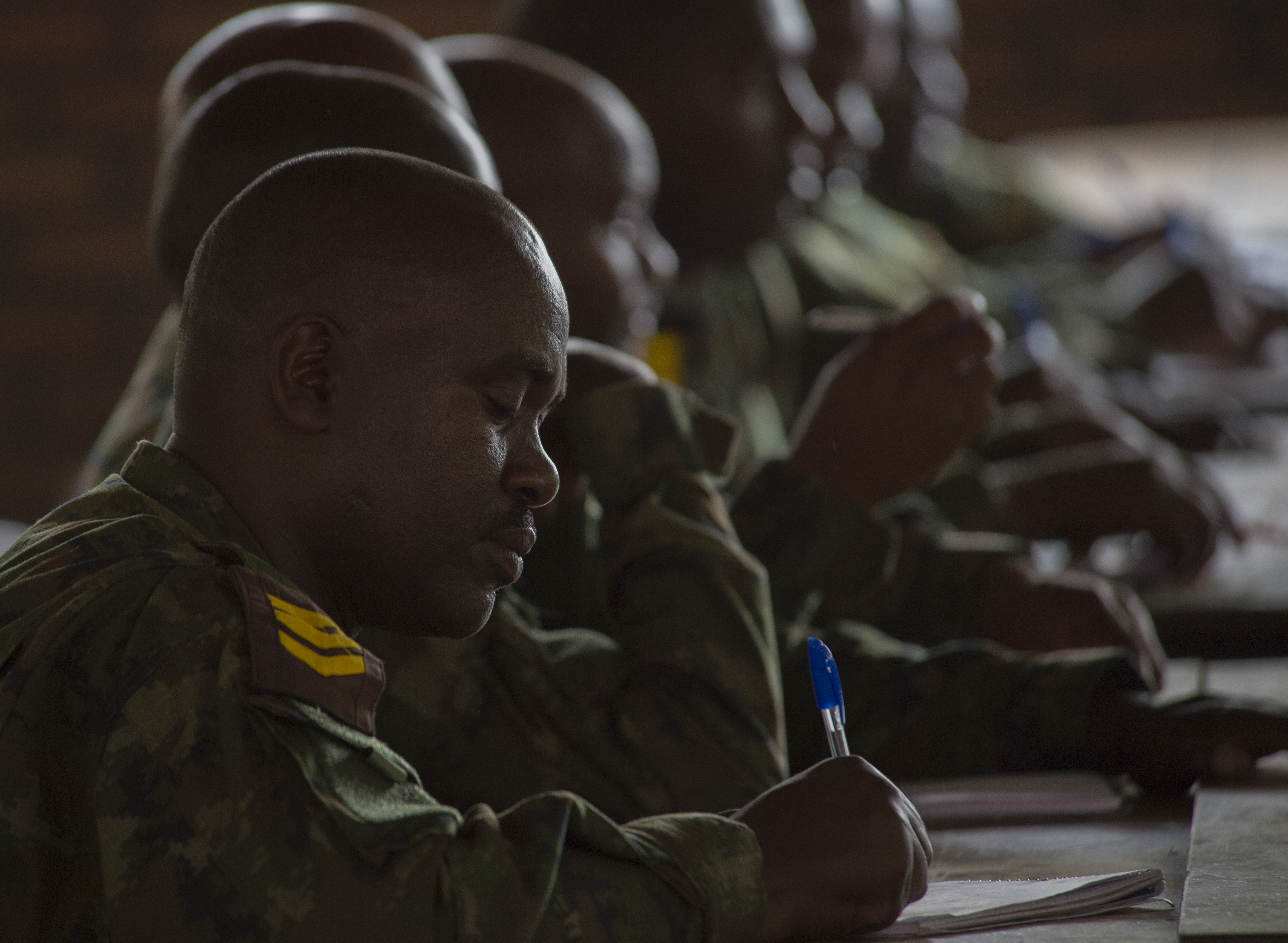 A Rwanda Defense Force noncommissioned officer takes notes during the patrolling portion of a NCO leadership course Sept. 9, 2016, at the Rwanda Military Academy, Rwanda. Members of 1st Battalion, 124th Infantry regiment, who are deployed from the Army National Guard to Combined Joint Task Force - Horn of Africa, observed the NCO course to provide advice and critiques to improve the class. (U.S. Air Force photo by Staff Sgt. Eric Summers Jr.)