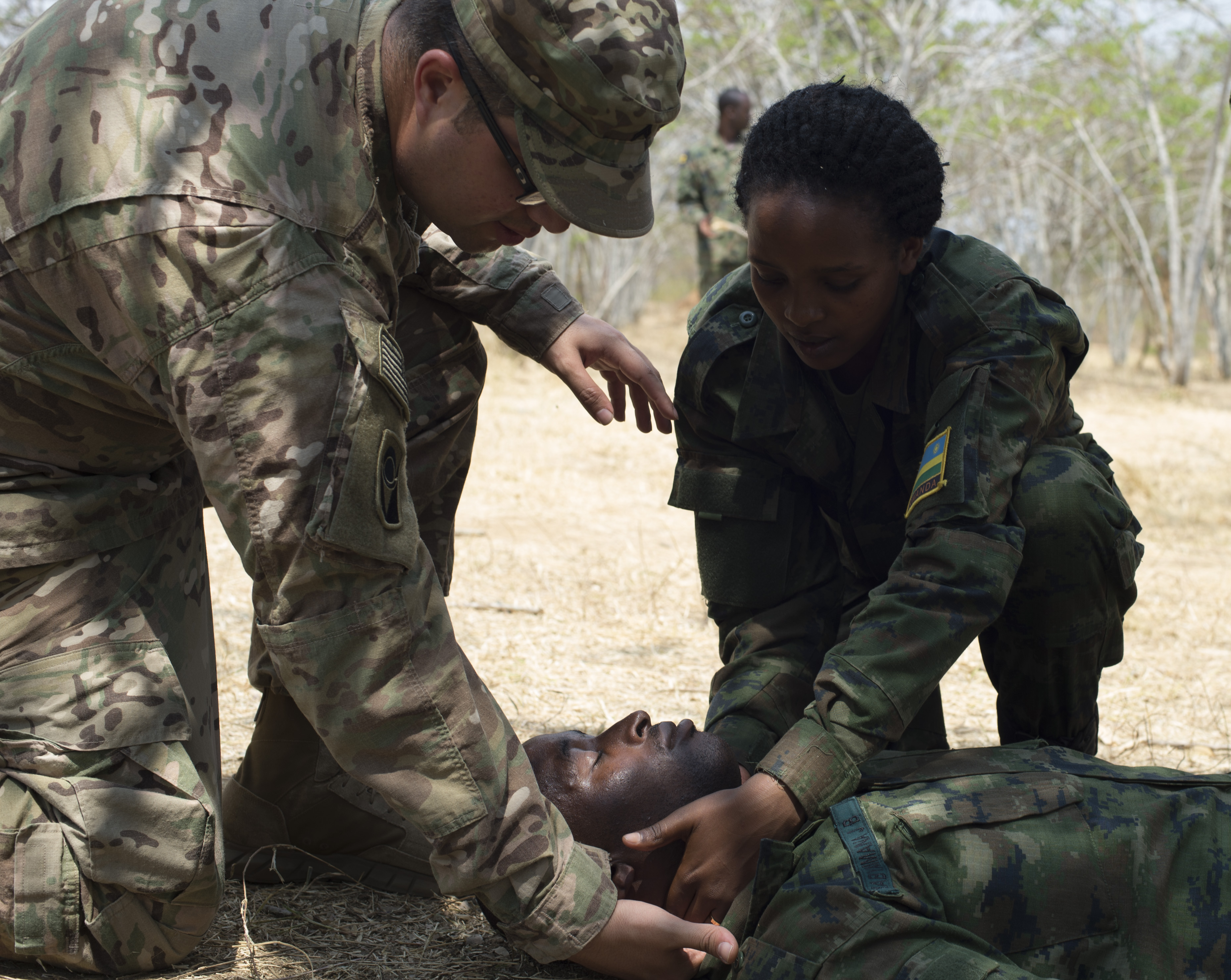 U.S. Army Sgt. Jonathan Lopez, 1st Battalion, 124th Infantry Regiment medic, shows a Rwanda Defense Force soldier where to look for a pulse to check the vitality of a mock casualty during a two-week medical course Sept. 8, 2016, at Rwanda Military Academy, Rwanda. U.S. Army soldiers, currently deployed to Combined Joint Task Force-Horn of Africa, taught the class. (U.S. Air Force photo by Staff Sgt. Eric Summers Jr.)