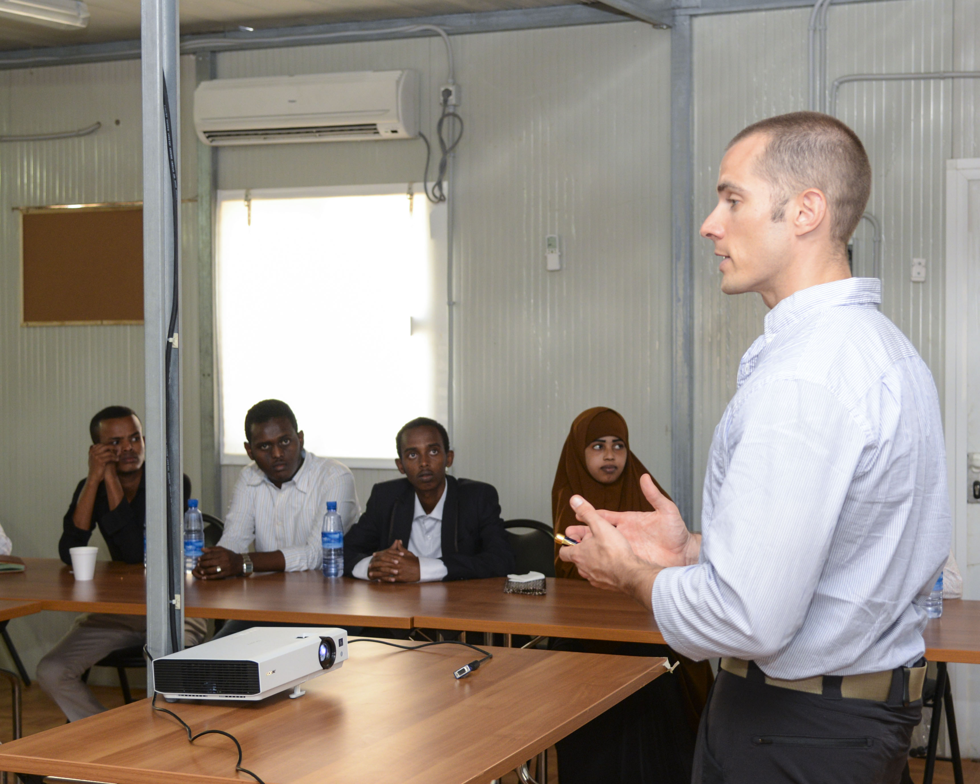 U.S. Army Maj. Andrew Mosier, 403rd Civil Affairs Battalion physician, instructs Somali doctors during the Continuing Medical Education Conference in Mogadishu, Somalia, Sept. 14, 2016. The conference brought nearly 20 medical students and general practitioners from various sectors of Somalia together to receive training on various medical practices, specifically in the fields of radiology and pediatrics. (U.S. Air Force photo by Staff Sgt. Benjamin Raughton)