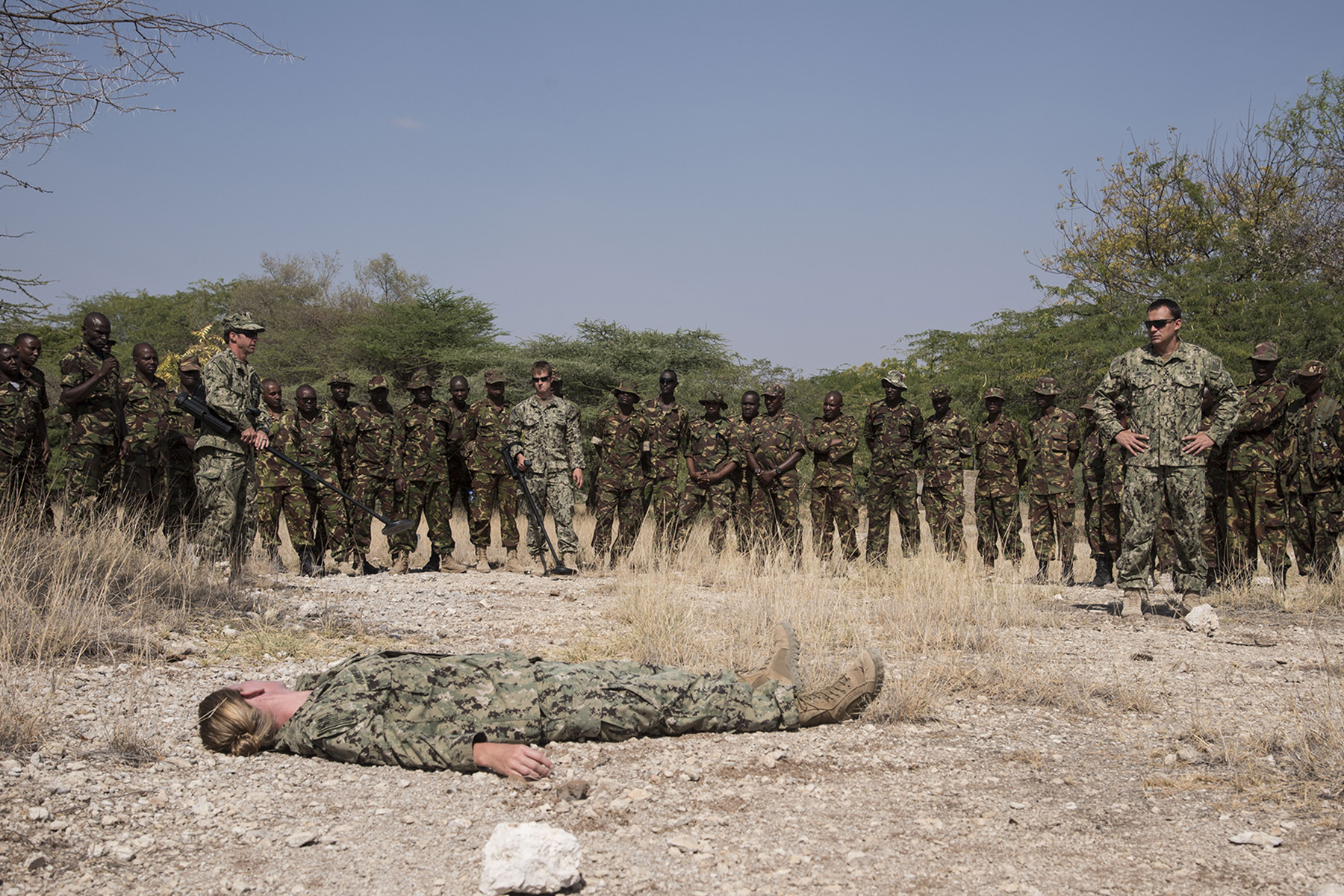 KENYA- U.S. Navy Sailors from Task Force Sparta, assigned to Combined Joint Task Force-Horn of Africa, demonstrate the final portion of the tactical combat medical training to Kenyan Defense Force combat engineers during Deliberate Kindle 2016, Sept. 15, at a Kenyan training facility. The medical training was just one portion of the four-week course designed to give Humanitarian Mine Action training to approximately 53 KDF soldiers and officers to prepare them for future deployments with the African Union Mission in Somalia. (U.S. Air Force photo by Staff Sgt. Tiffany DeNault)