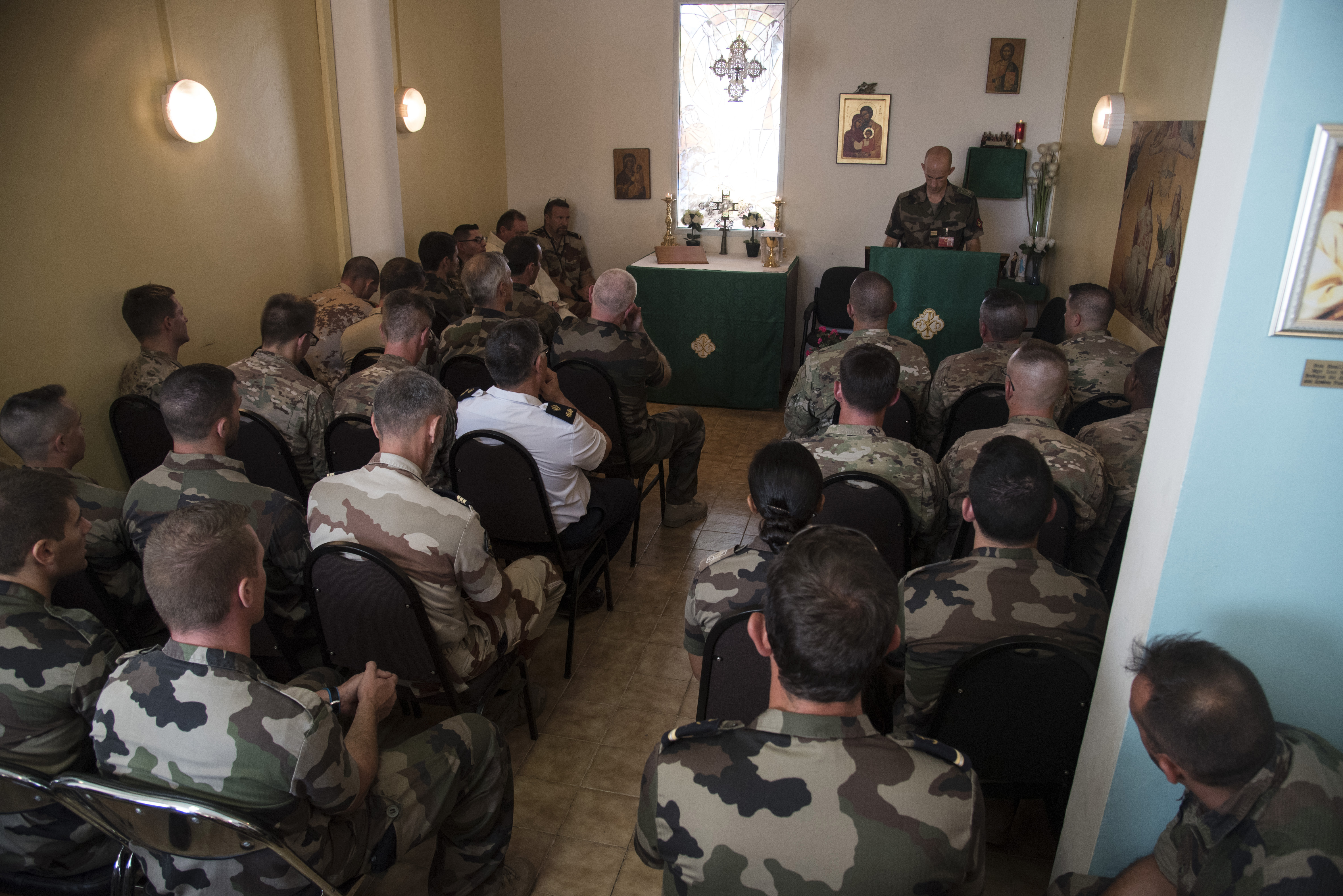 DJIBOUTI- U.S., French and Djiboutian airborne forces attend a church mass honoring St. Michel's day, the patron saint of paratroopers, Sept. 29, 2016, at the French air base in Djibouti City, Djibouti. The airborne forces began the celebrations with a static line and high altitude low opening jump toward a designated drop zone, followed by a church mass and a ceremony where several U.S. airborne forces were awarded French jump wings. (U.S. Air Force photo by Staff Sgt. Tiffany DeNault)