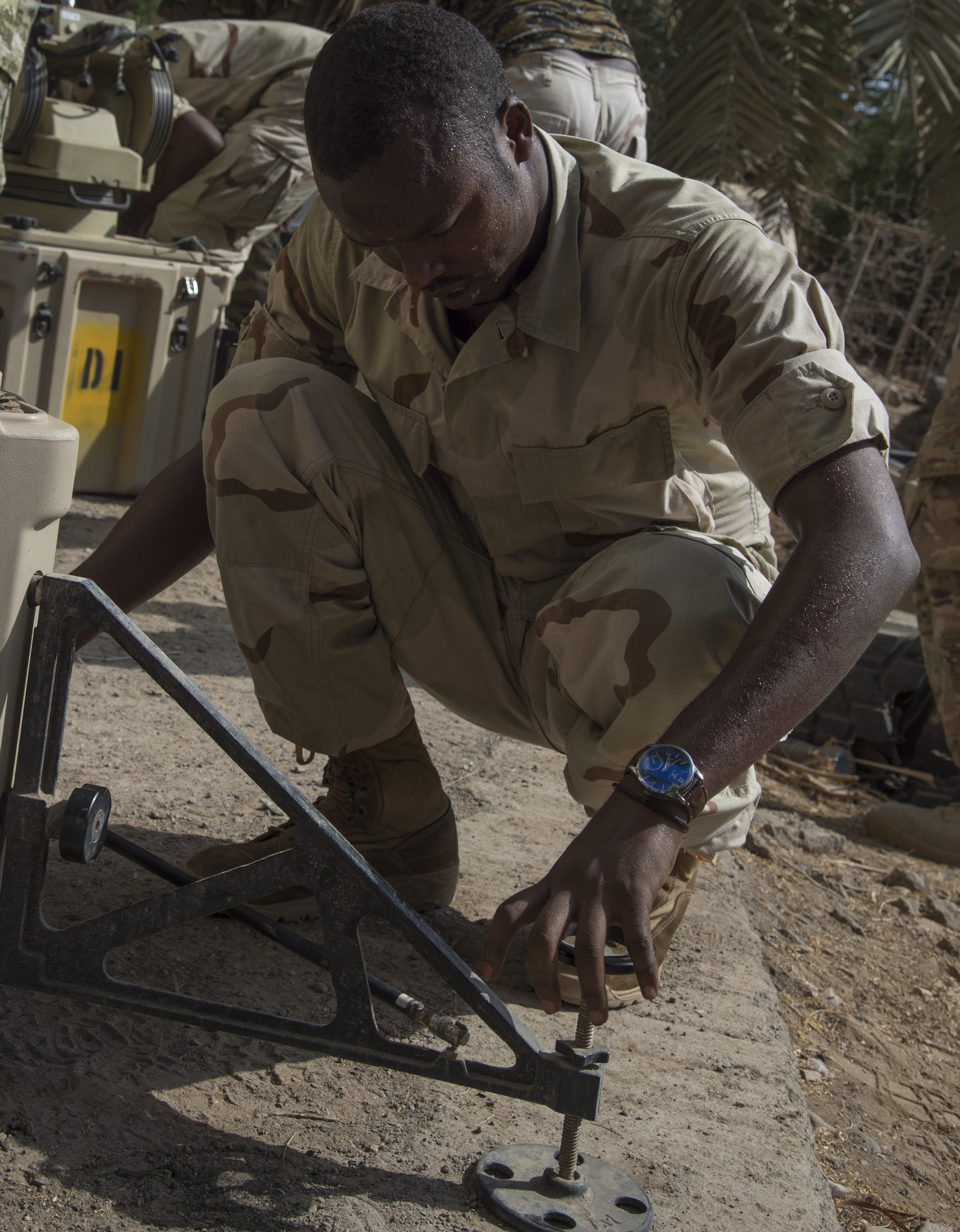 A Djibouti Armed Forces (FAD) soldier secures the legs to an Africa Data Sharing Network (ADSN) satellite during a best practices training with U.S. Army Soldiers Sept. 28, 2016, at FAD Headquarters in Djibouti. While conducting the best practices training, the U.S. Army, assigned to Combined Joint Task-Horn of Africa, also held an ADSN validation with the FAD soldiers to prepare them to deploy to Somalia.  The ADSN provides network and Voice over Internet Protocol capabilities between several African countries participating in the Africa Union Mission in Somalia. (U.S. Air Force photo by Staff Sgt. Eric Summers Jr.)