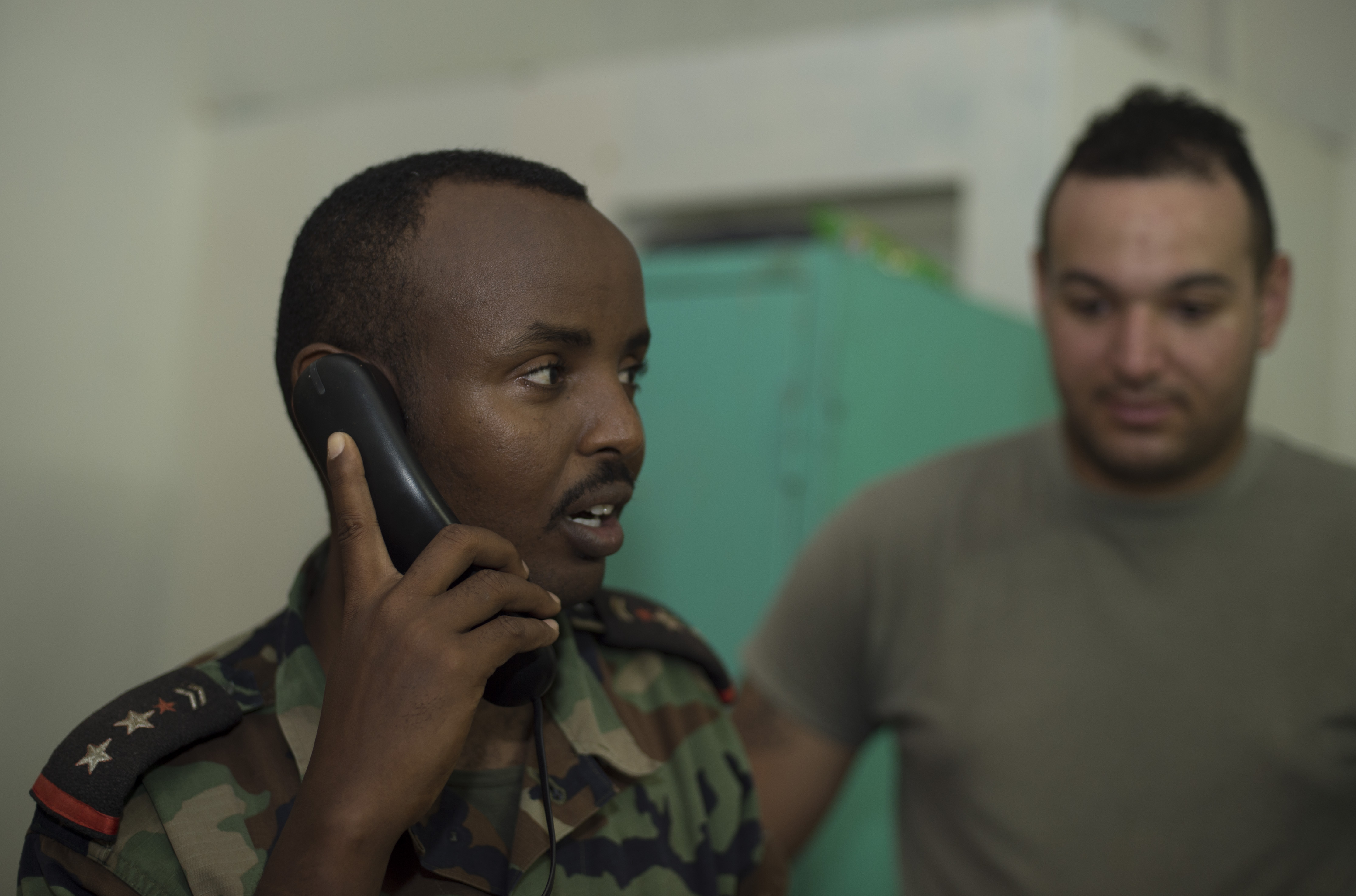 A Djibouti Armed Forces service member places a call to confirm connectivity of a Voice over Internet Protocol phone during validation training Sept. 28, 2016, at FAD Headquarters in Djibouti.  While conducting the best practices training, the U.S. Army technicians assigned to Combined Joint Task-Horn of Africa also held an Africa Data Sharing Network validation with the FAD soldiers, to prepare them to deploy to Somalia.  The ADSN provides network and Voice over Internet Protocol capabilities between the several African countries participating in the Africa Union Mission in Somalia. (U.S. Air Force photo by Staff Sgt. Eric Summers Jr.)