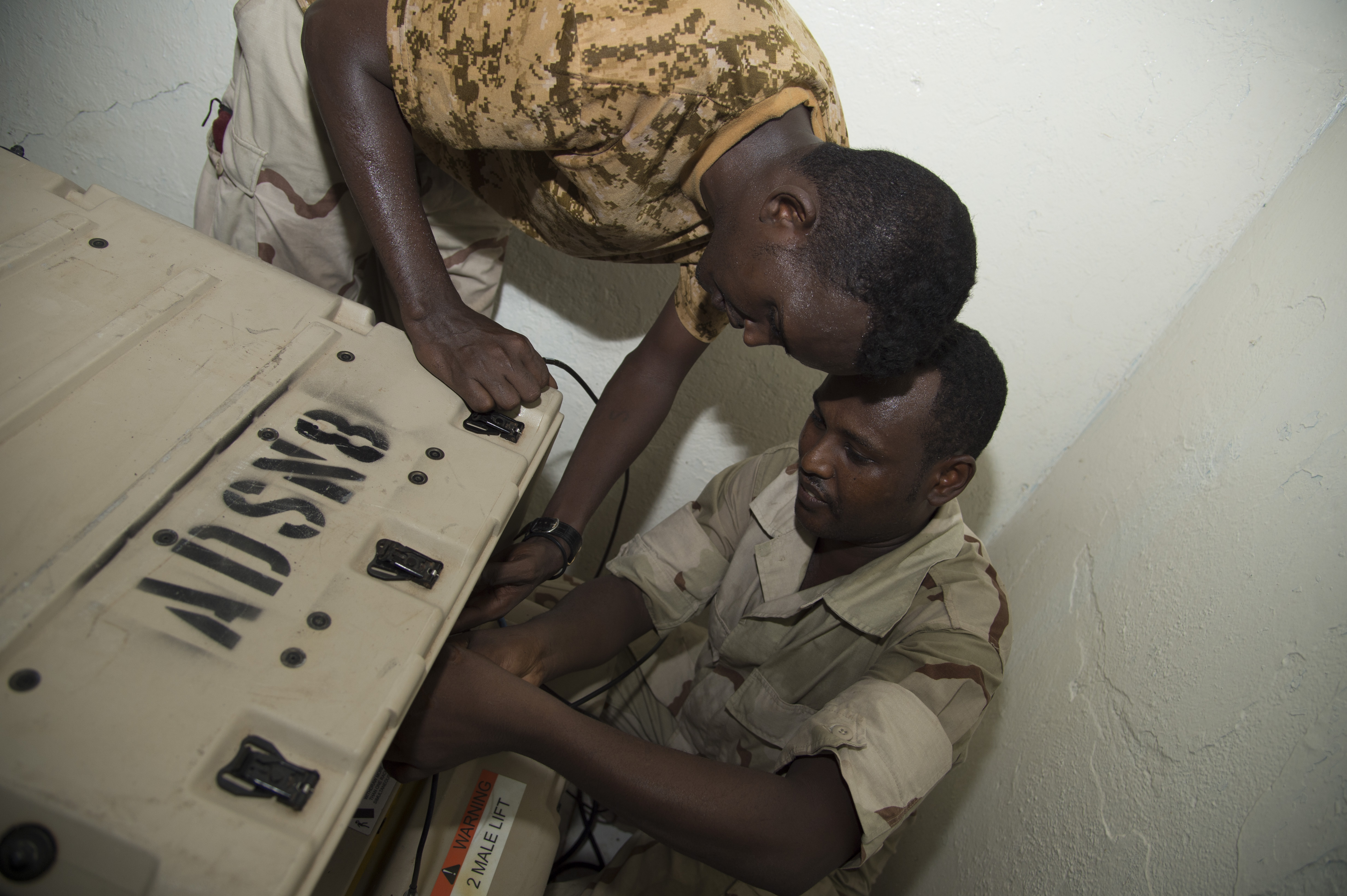 Djibouti Armed Forces (FAD) service members set up a modem for the Africa Data Sharing Network (ADSN) during a training validation Sept. 29, 2016, at FAD Headquarters in Djibouti. While conducting the best practices training, the U.S. Army, assigned to Combined Joint Task-Horn of Africa, also held an ADSN validation with the FAD soldiers to prepare them to deploy to Somalia.  The ADSN provides network and Voice over Internet Protocol capabilities between the several African countries participating in the Africa Union Mission in Somalia. (U.S. Air Force photo by Staff Sgt. Eric Summers Jr.)