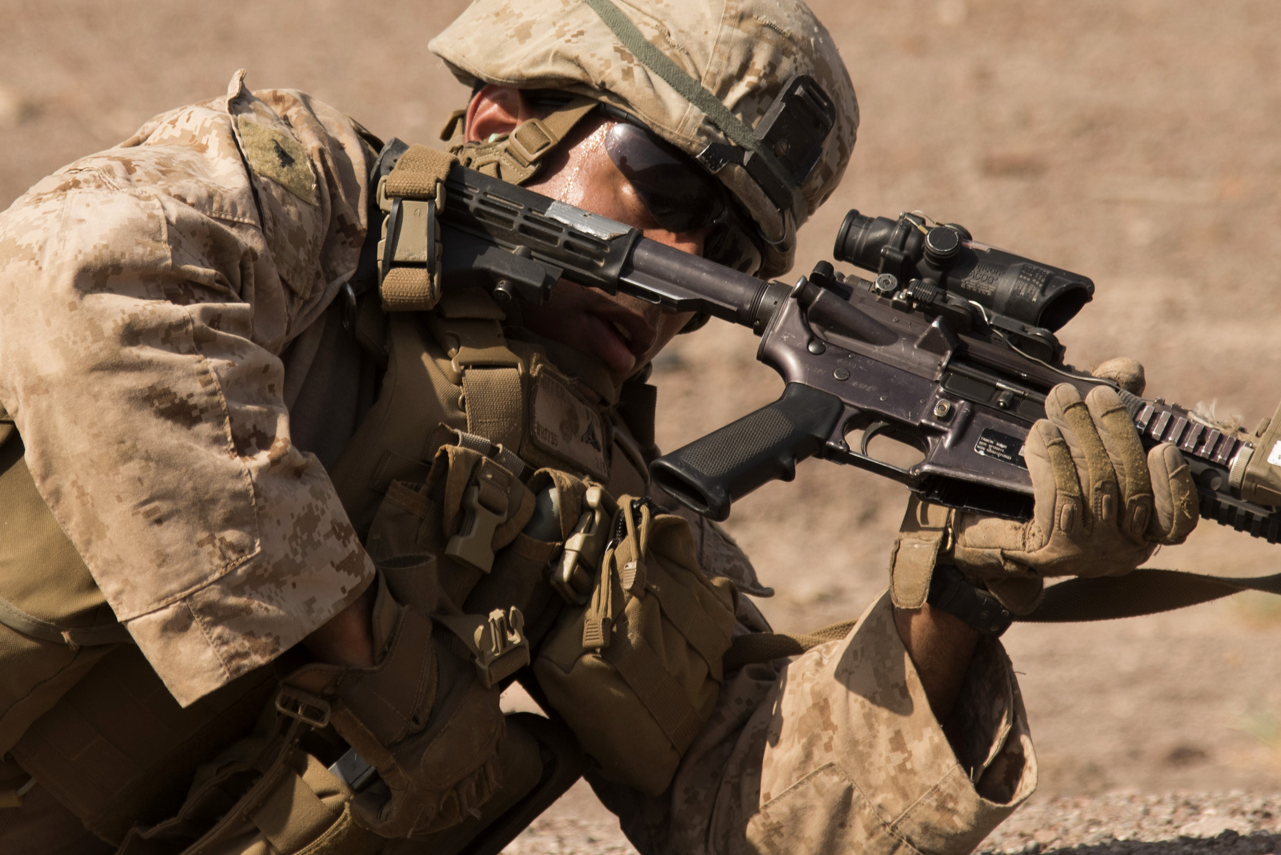 ARTA, Djibouti – U.S. Marine Corps Lance Cpl. Khalil Hitt, Special-Purpose Marine Air-Ground Task Force Crisis Response-Africa (SPMAGTF-CR-AF) machine gunner, reloads his M4 carbine during live fire range drills for small arms fire team training, Oct. 5, 2016, at Arta, Djibouti. Assigned to Combined Joint Task Force-Horn of Africa, SPMAGTF-CR-AF completed team level range drills to continue sustainment of core skills and build from individual skill levels. The next level of training will consist of squad training. (U.S. Air Force photo by Staff Sgt. Tiffany DeNault)