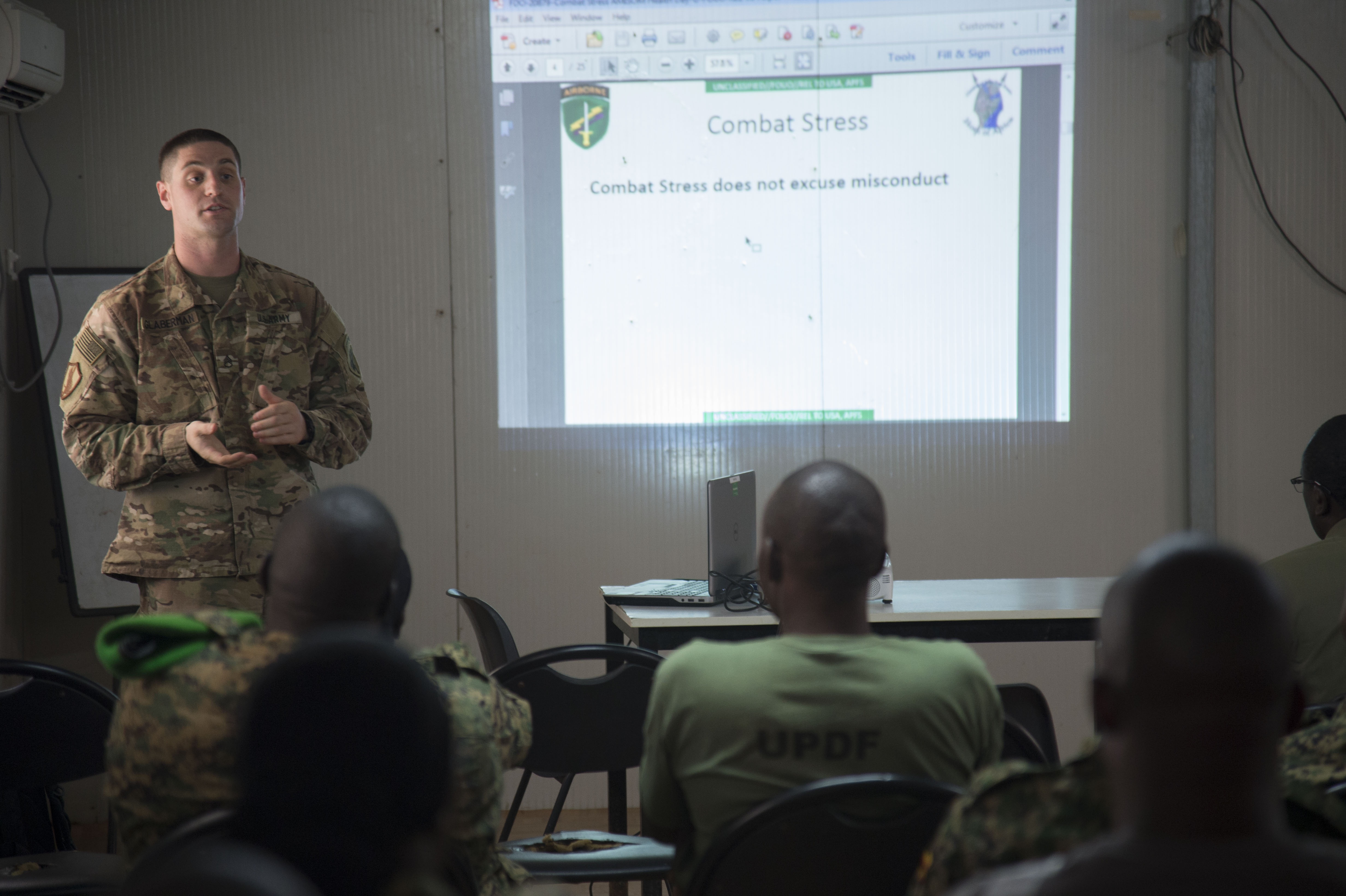 U.S. Army Staff Sgt. Matthew Glaberman, Charlie Company, 411th Civil Affairs Battalion operations sergeant, discusses combat stress during a mental health sharing of best practices class Oct. 10, 2016, at Mogadishu, Somalia. Glaberman spoke with the attendees about how to identify signs of combat stress and methods to treat it. (U.S. Air Force photo by Staff Sgt. Eric Summers Jr.)