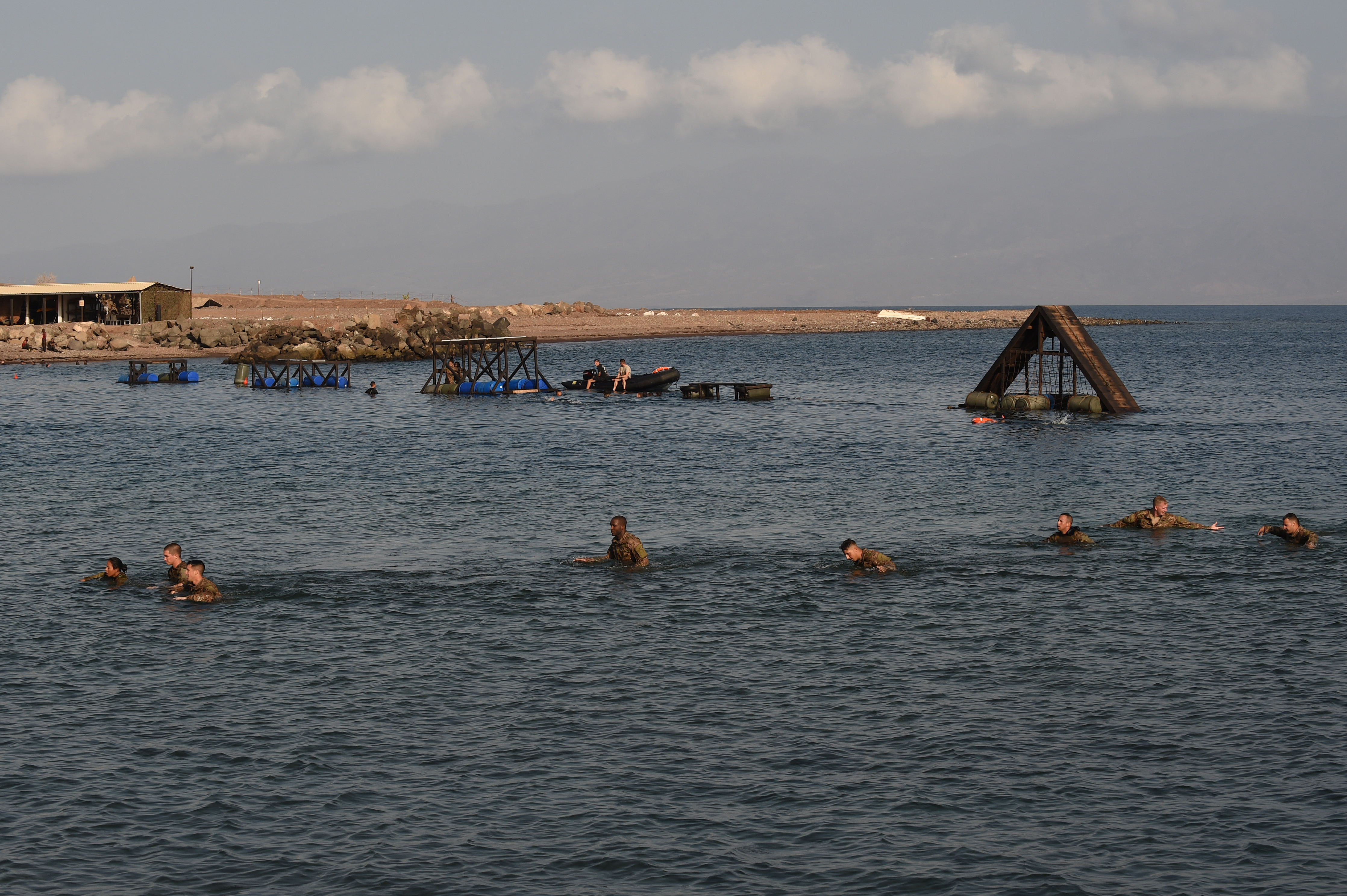 ARTA PLAGE, Djibouti – U.S. Army Soldiers from the 1st Battalion, 124th Infantry Regiment, assigned to Combined Joint Task Force-Horn of Africa, complete a water obstacle course as part of the French Marines Desert Survival Course, Oct. 10, 2016, at Arta Plage, Djibouti. Approximately 46 U.S. Army Soldiers with French Marines completed several tasks during the survival course, including desert operations, combat lifesaving skills, weapons training, survival cooking, how to decontaminate water, and water and mountain obstacle courses. (U.S. Air Force photo by Staff Sgt. Tiffany DeNault)