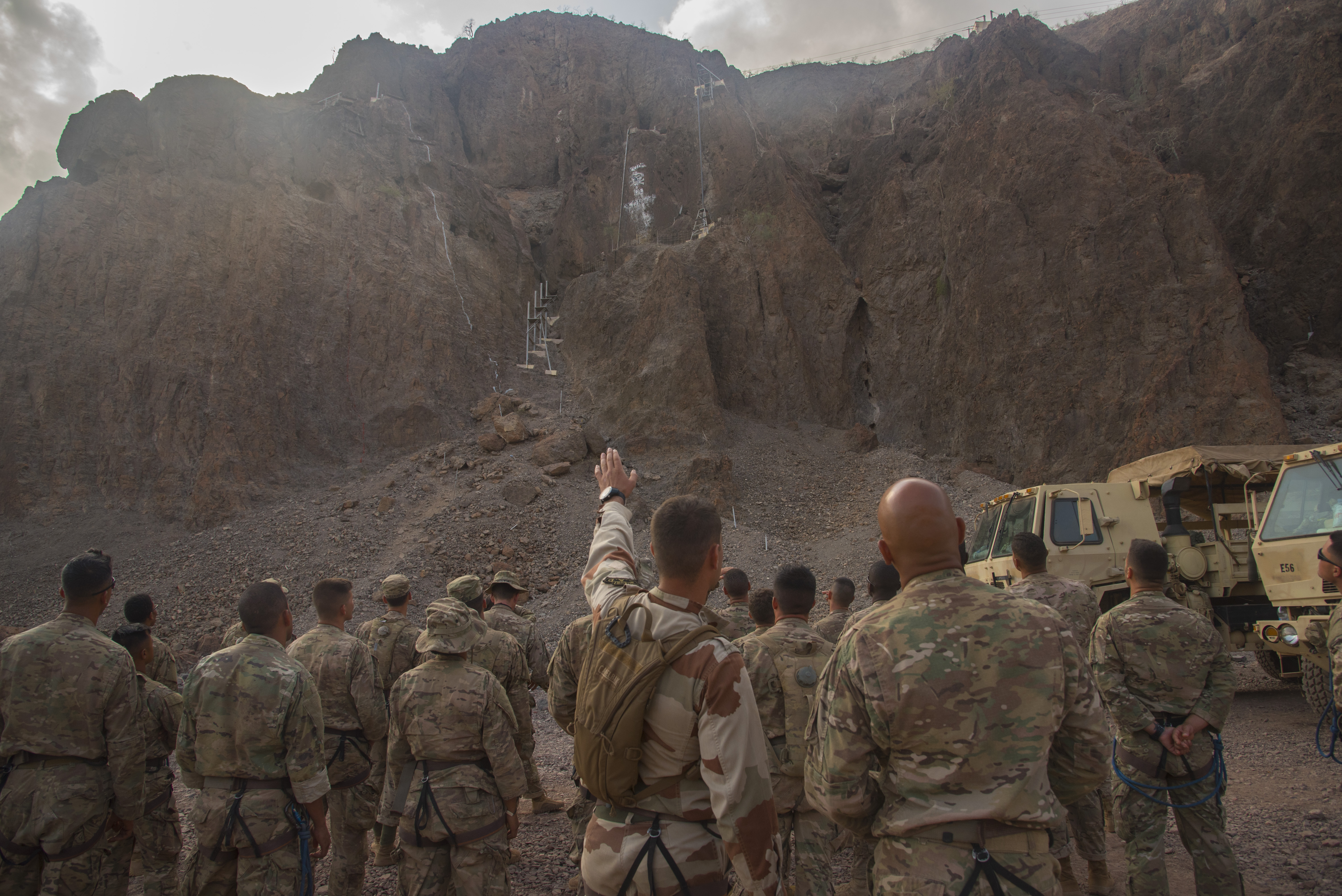 ARTA PLAGE, Djibouti – U.S. Army Soldiers from the 1st Battalion, 124th Infantry Regiment, assigned to Combined Joint Task Force-Horn of Africa, begin the the mountain obstacle course portion of the French Marines Desert Survival Course, Oct. 10, 2016, at Arta Plage, Djibouti. Approximately 46 U.S. Army Soldiers with French Marines completed several tasks during the survival course, including desert operations, combat lifesaving skills, weapons training, survival cooking, how to decontaminate water, and water and mountain obstacle courses. (U.S. Air Force photo by Staff Sgt. Tiffany DeNault)