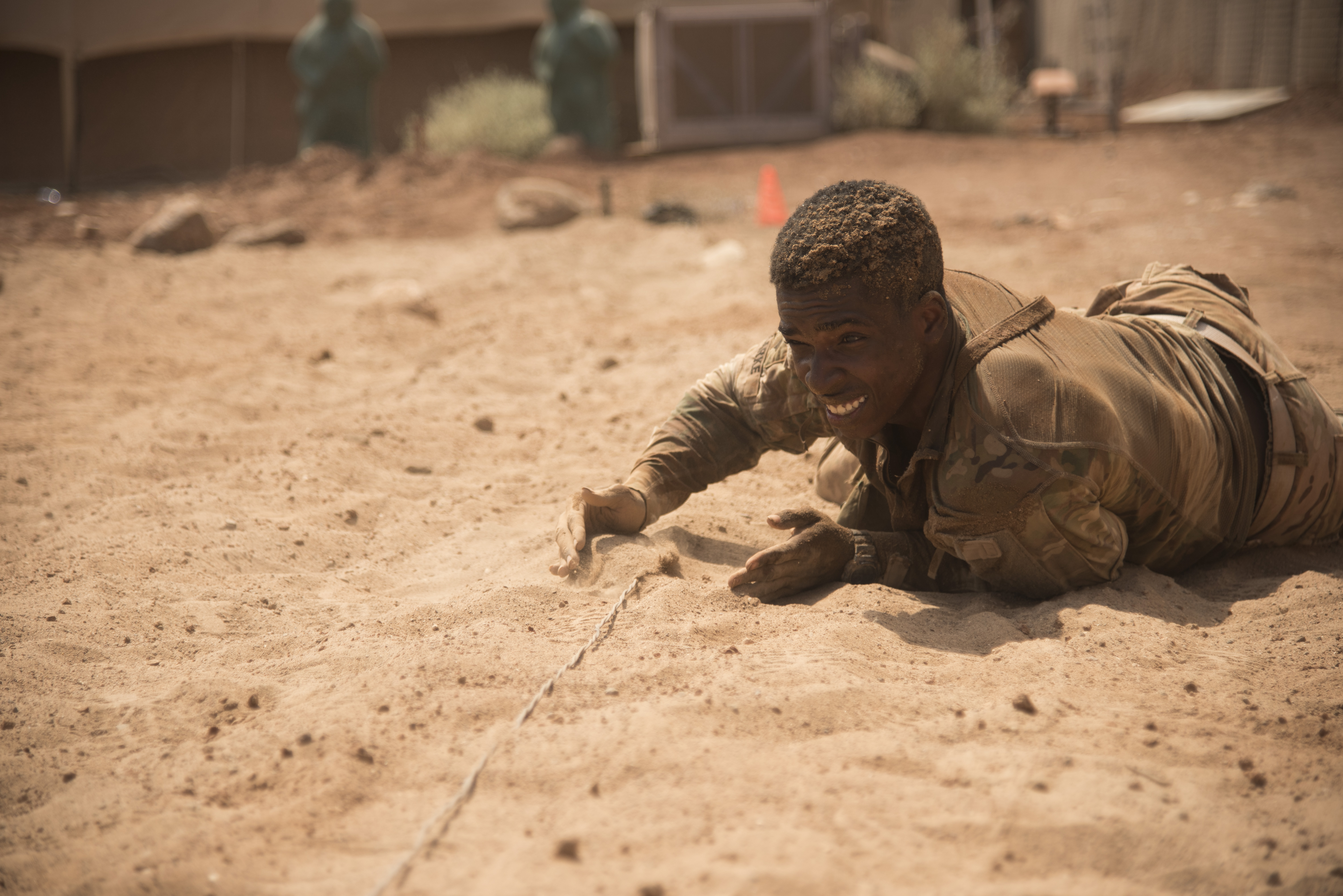 DJIBOUTI- U.S. Army Spc. Carey Clarke, 1st Battalion, 124th Infantry Regiment, hides a wire after securing a mock claymore mine during a spur ride event, Oct. 21, 2016, at a nearby airfield, in Djibouti. Twenty-eight U.S. Army Soldiers and one Air Force Airman participated in the traditional Army event where they completed 10 tasks with various stress events before each task in approximately 19 hours. (U.S. Air Force photo by Staff Sgt. Tiffany DeNault)