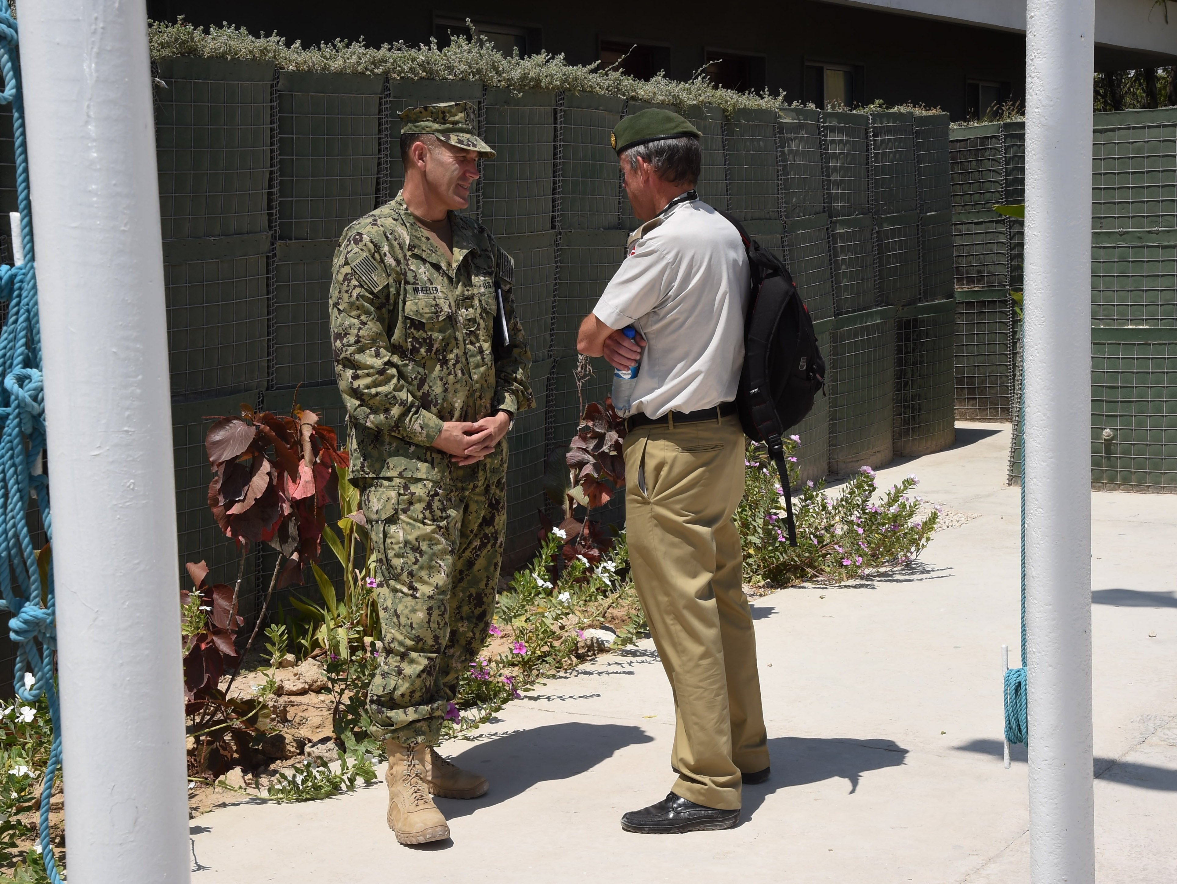 U.S. Navy Rear Adm. William Wheeler III, deputy commander of Combined Joint Task Force-Horn of Africa (CJTF-HOA), and Col. Søren Knudsen, Military Advisor to the Royal Danish Embassy and Defense Attaché Kenya, Nairobi, converse after a defense steering committee meeting, Nov. 3, 2016, in Mogadishu, Somalia. The venue allowed members to discuss Somalian defense security situations, AMISOM challenges, and the current dynamics seen by all sides. These meetings align with the CJTF-HOA mission of supporting and enabling the stabilization of Somalia. (U.S. Air Force photo by Staff Sgt. Penny Snoozy)
