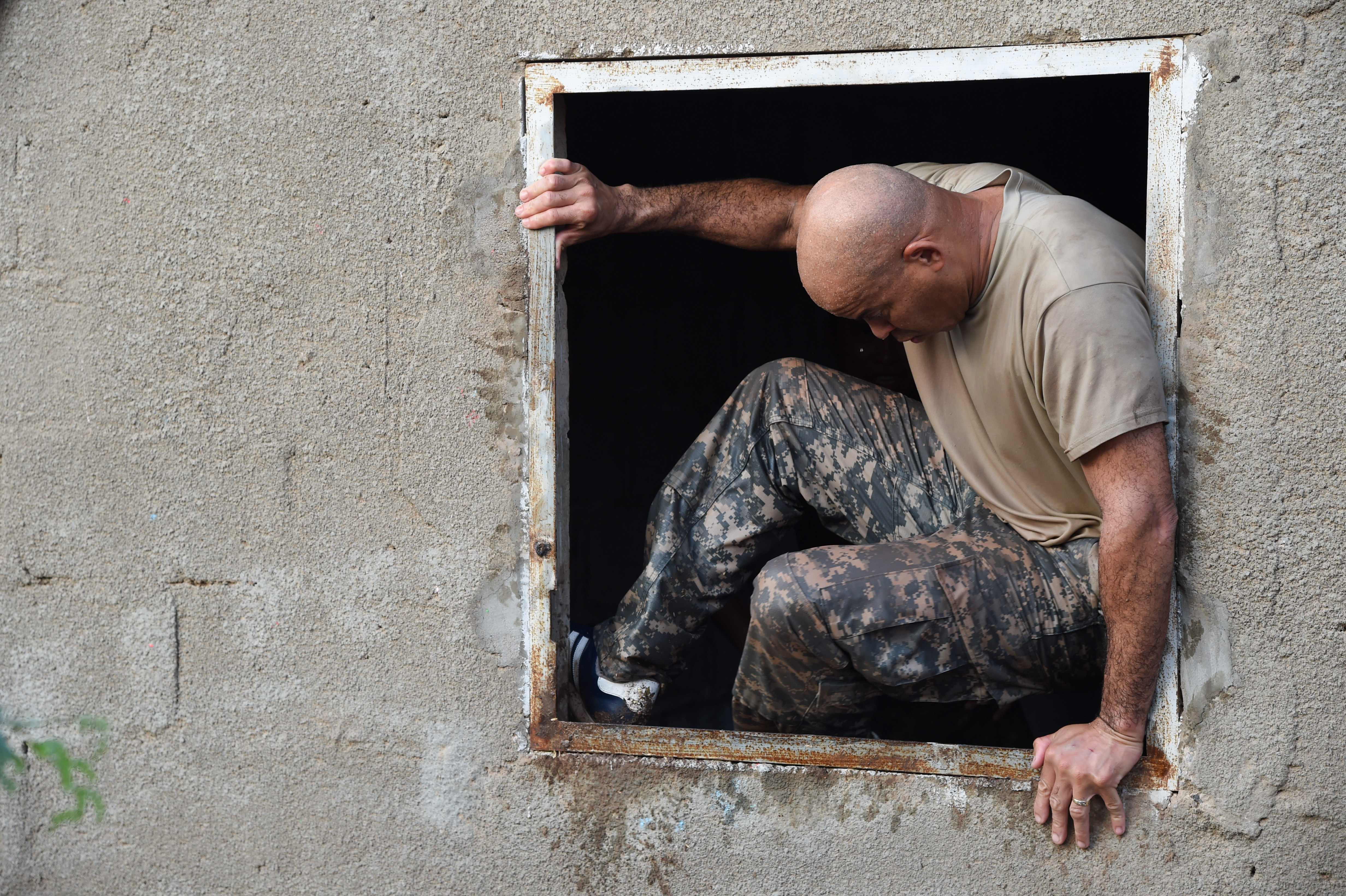 U.S. Army Sgt. Maj. Rodger Campbell, Combined Joint Task Force-Horn of Africa Civil Affairs, jumps through a window obstacle during a mud run hosted by the French military, Nov. 6, 2016, in Djibouti, Djibouti. The event allowed coalition forces from French, Japanese, and American teams to interact and build camaraderie while navigating a five kilometer course. The French 5th Marine Regiment team took first place. (U.S. Air Force photo by Staff Sgt. Penny Snoozy)