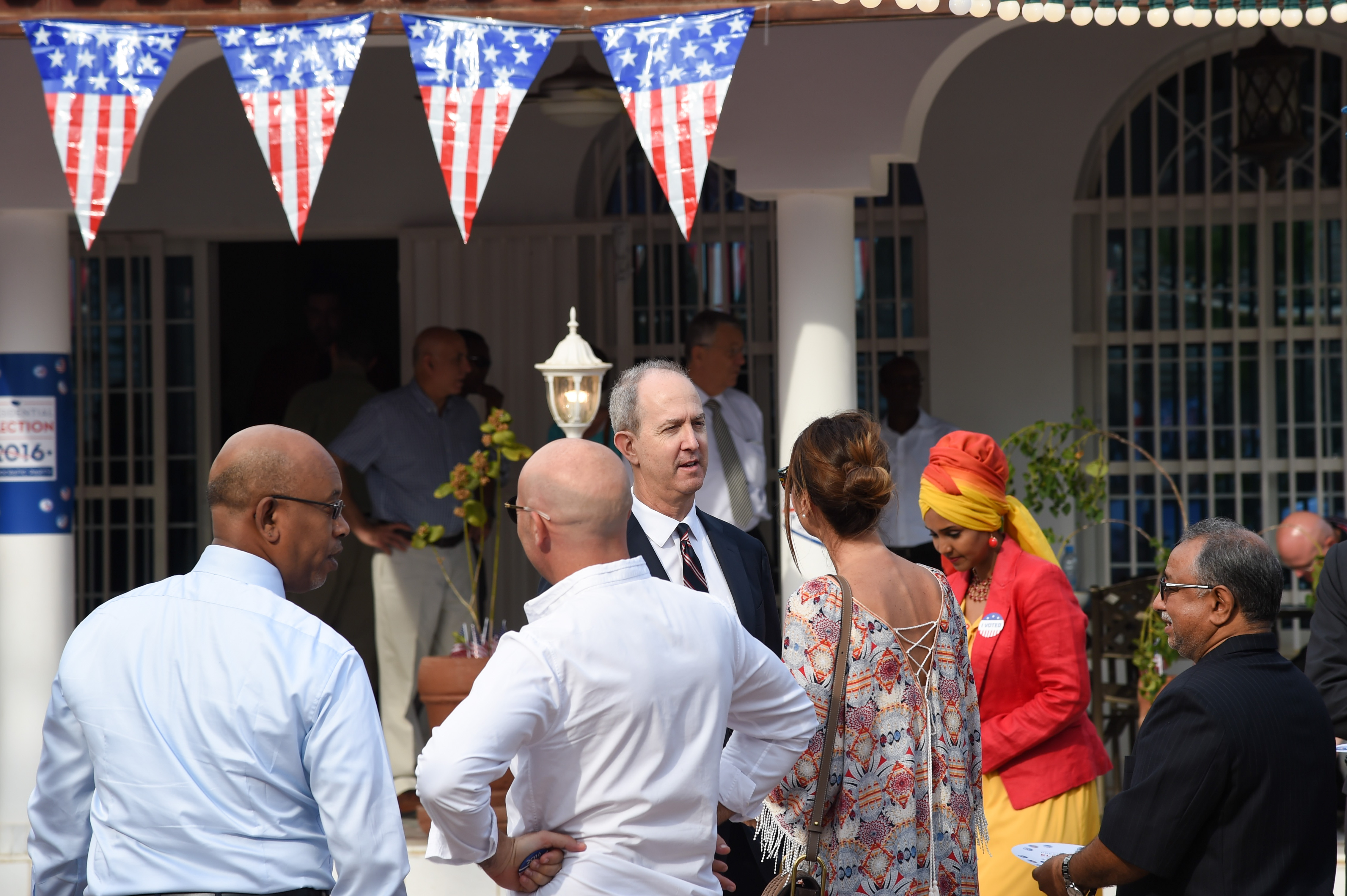 Thomas P. Kelly III, U.S. Ambassador to Djibouti, greets guests at his home during an Election Day breakfast, Nov. 10, 2016, in Djibouti, Djibouti. The event allowed political leaders, American community members, youth leaders, and members of the business community to participate in a celebration of American values and traditions. (U.S. Air National Guard photo by Staff Sgt. Penny Snoozy)