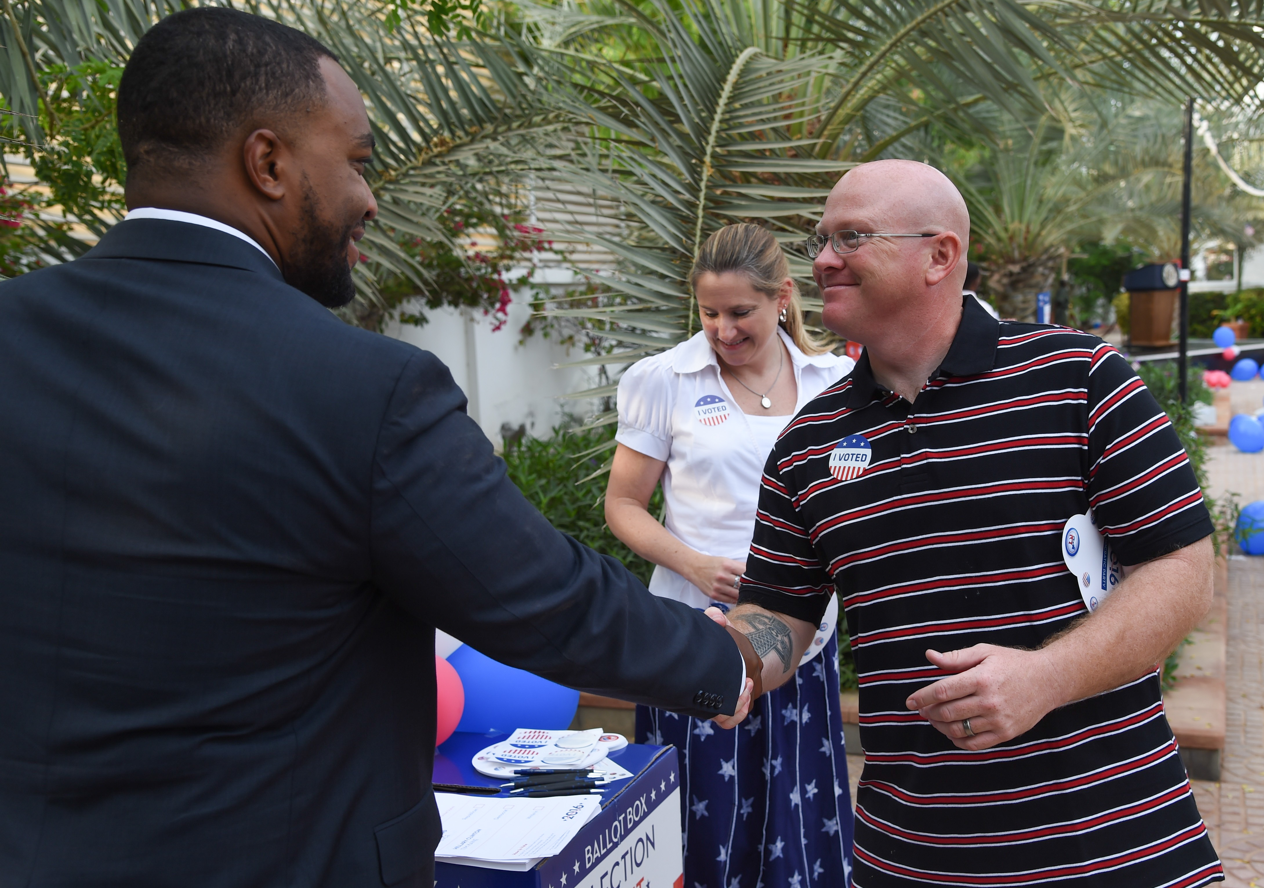 U.S. Air Force Tech. Sgt. Timothy Gallagher, Combined Joint Task Force-Horn of Africa, Public Affairs Office, and other guests of the U.S. Ambassador to Djibouti vote in a mock election during an election day breakfast, Nov. 9, 2016, in Djibouti, Djibouti. The event allowed political leaders, American community members, youth leaders, and members of the business community to participate in a celebration of American values and traditions. (U.S. Air National Guard photo by Staff Sgt. Penny Snoozy)