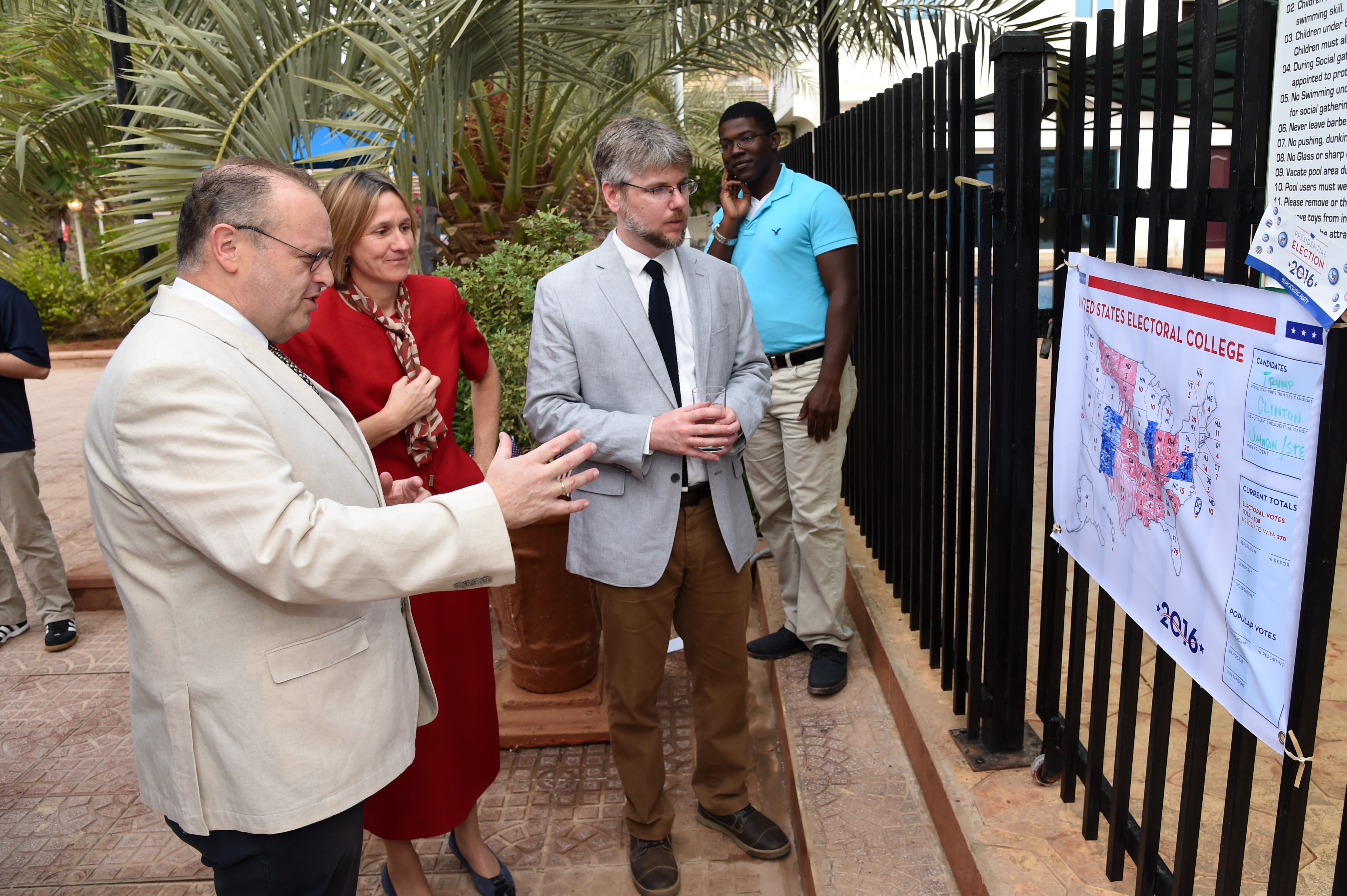 Guests of Thomas P. Kelly III, U.S. Ambassador to Djibouti, look at an electoral map during an Election Day breakfast at his home, Nov. 9, 2016, in Djibouti, Djibouti. The event allowed political leaders, American community members, youth leaders, and members of the business community to participate in a celebration of American values and traditions. (U.S. Air National Guard photo by Staff Sgt. Penny Snoozy)