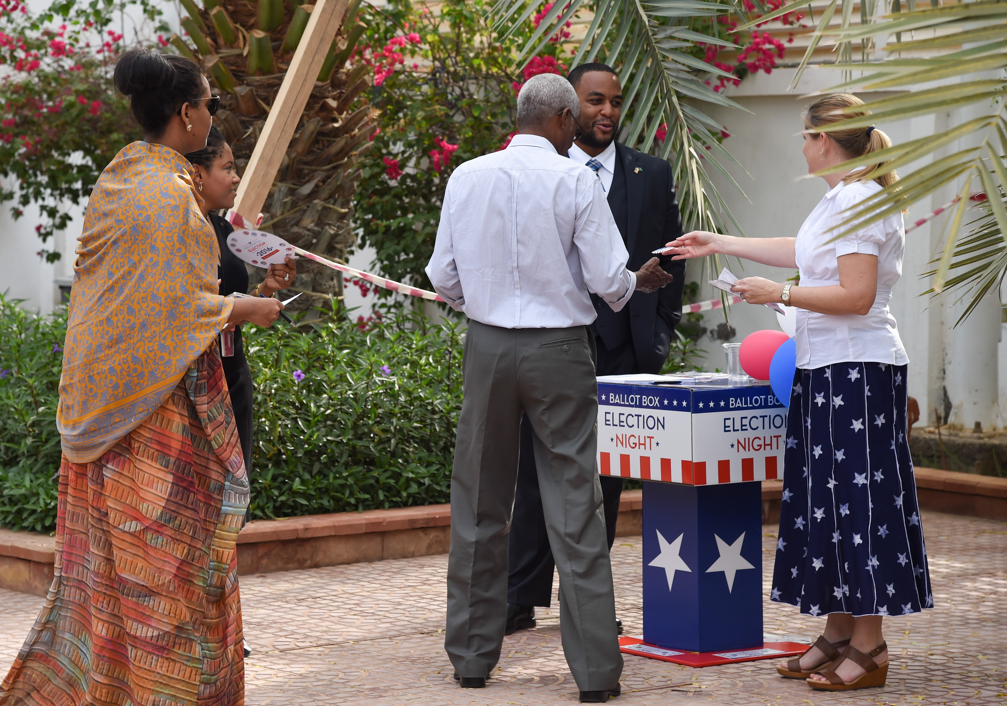 Guests of Thomas P. Kelly III, U.S. Ambassador to Djibouti, vote in a mock election held during an Election Day breakfast, Nov. 9, 2016, in Djibouti, Djibouti. The event allowed political leaders, American community members, youth leaders, and members of the business community to participate in a celebration of American values and traditions. (U.S. Air National Guard photo by Staff Sgt. Penny Snoozy)
