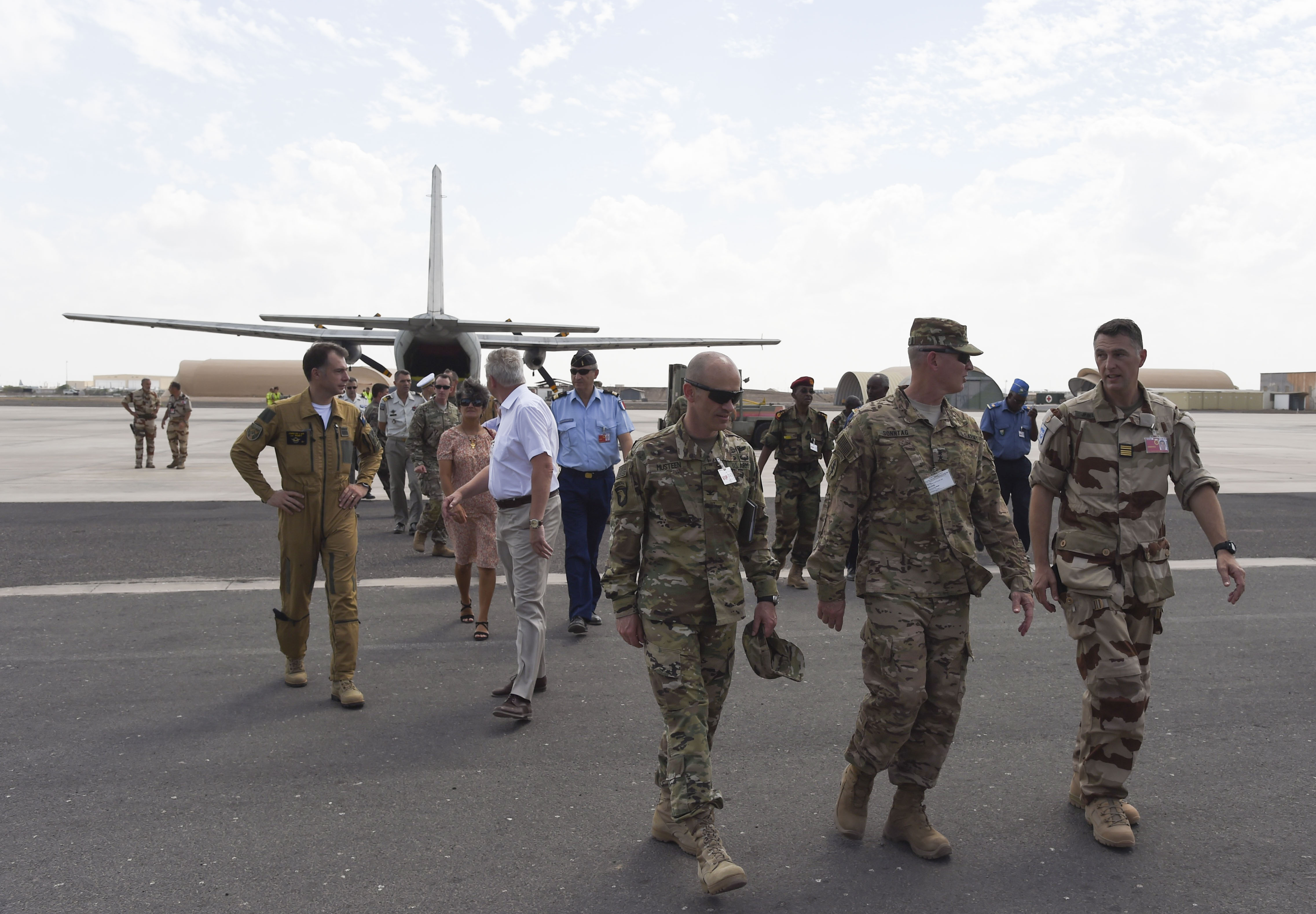 U.S. service members assigned to Combined Joint Task Force-Horn of Africa and distinguished visitors leave the runway after the completion of a non-combatant evacuation exercise (NEO) at the French Marine 5th Regiment, Nov. 16, 2016, in Djibouti, Djibouti. The French invited international partners to the exercise to allow them to observe and exchange information about the event. The NEO exercise gave the French and their guests the opportunity to practice an evacuation with international partners. (U.S. Air National Guard photo by Staff Sgt. Penny Snoozy)