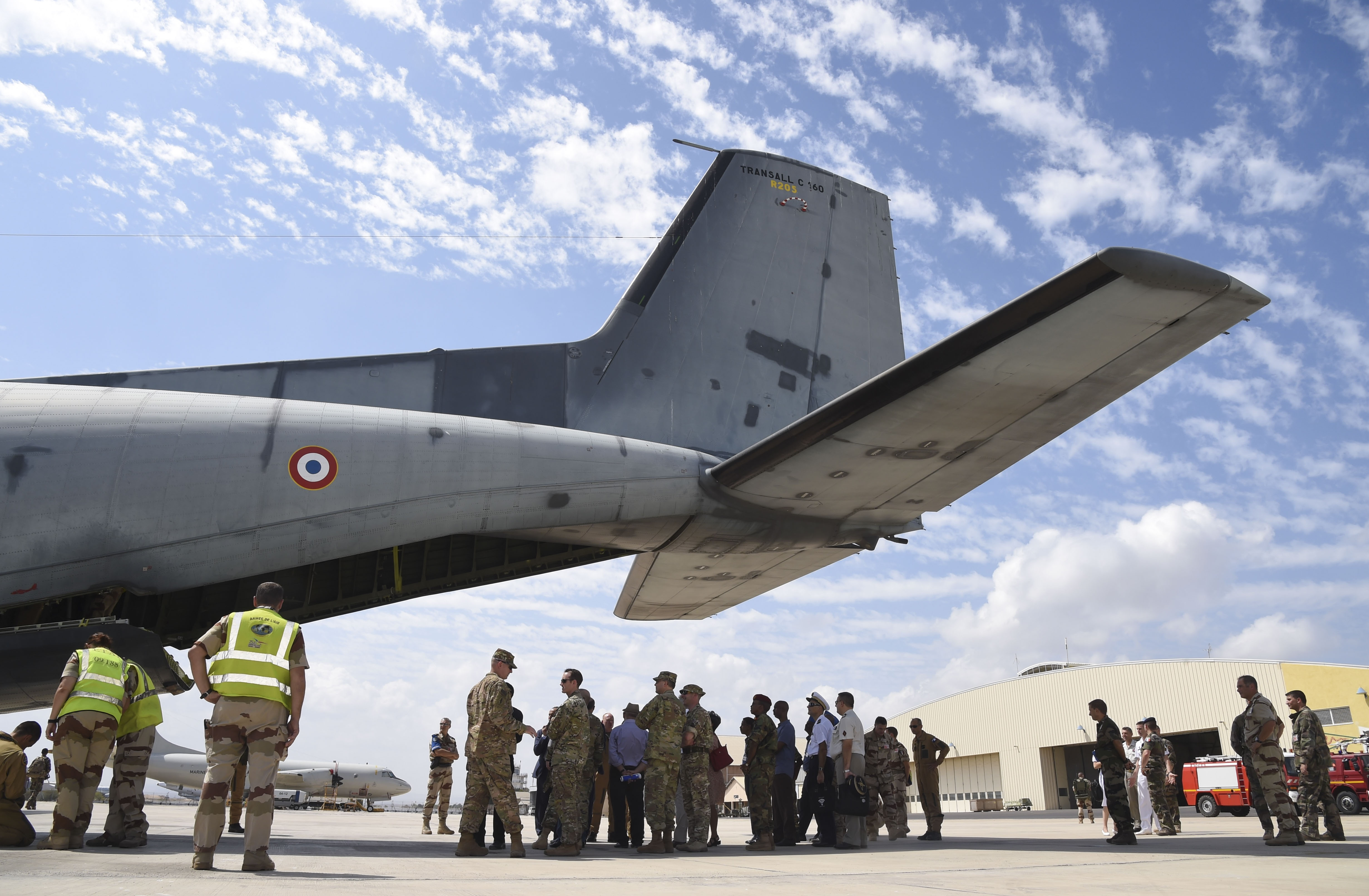 U.S. service members assigned to Combined Joint Task Force-Horn of Africa and distinguished visitors, and volunteers load onto an aircraft and observe the process during a non-combatant evacuation exercise (NEO) at the French Marine 5th Regiment, Nov. 16, 2016, in Djibouti, Djibouti. The French invited international partners to the exercise to allow them to observe and exchange information about the event. The NEO exercise gave the French and their guests the opportunity to practice an evacuation with international partners. (U.S. Air National Guard photo by Staff Sgt. Penny Snoozy)