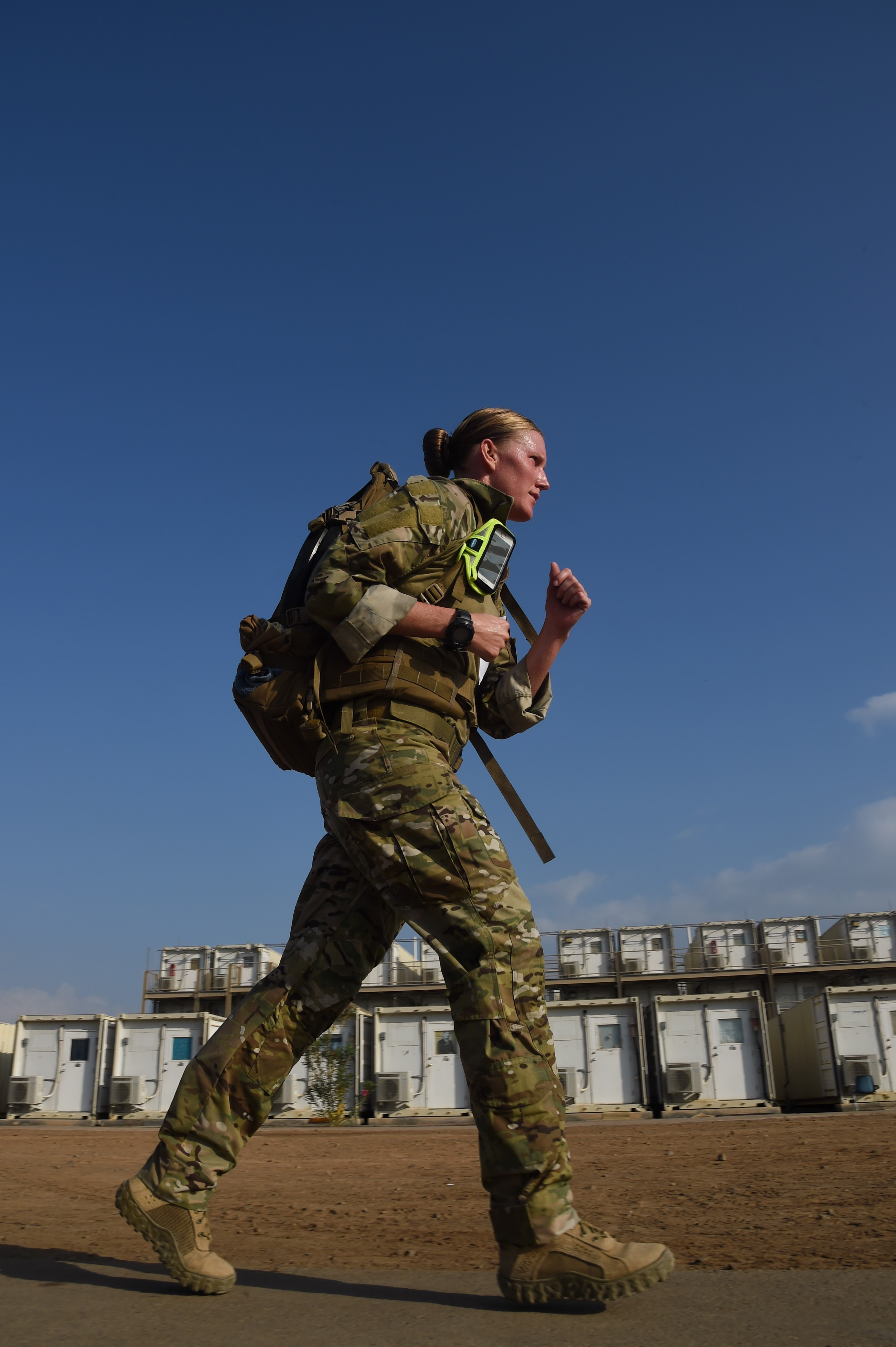 U.S. Navy Lt. j.g. Christina Hammervold, Task Force Sparta platoon commander, runs a five-mile Army ruck march during the Joint Warrior Competition, Nov. 19, 2016, Camp Lemonnier, Djibouti. The ruck march began after participants had already completed a two-mile run, pull-ups, sit-ups, and push-ups. Members had to carry a minimum of 35 pounds during the march. (U.S. Air National Guard photo by Staff Sgt. Penny Snoozy)